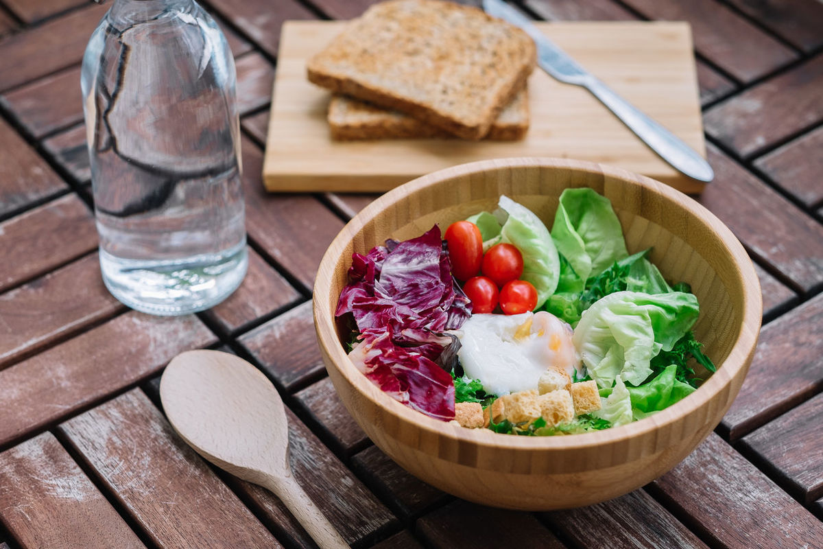 Salad Bowl Bread Close-up Cutting Board Day Egg Food Food And Drink Freshness Healthy Eating High Angle View No People Outdoors Ready-to-eat Salad Bar SLICE Table Tomato Vegetable Wood - Material