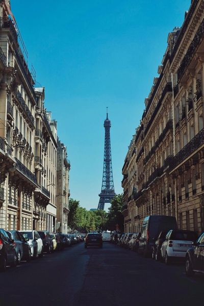 Architecture Built Structure Building Exterior Car Transportation Land Vehicle Tower City Mode Of Transport Travel Destinations Travel Street Day Outdoors Blue City Life Sky Road Clear Sky No People Paris Eiffel Tower France