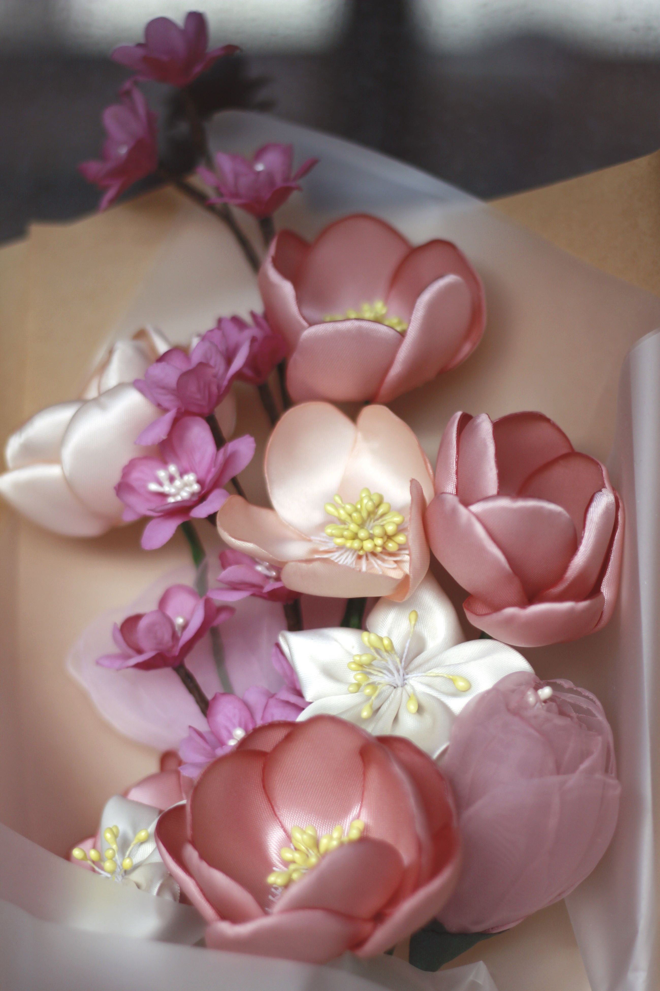indoors, flower, freshness, pink color, fragility, close-up, vase, petal, bouquet, table, decoration, flower arrangement, still life, home interior, focus on foreground, flower head, rose - flower, bunch of flowers, pink, high angle view