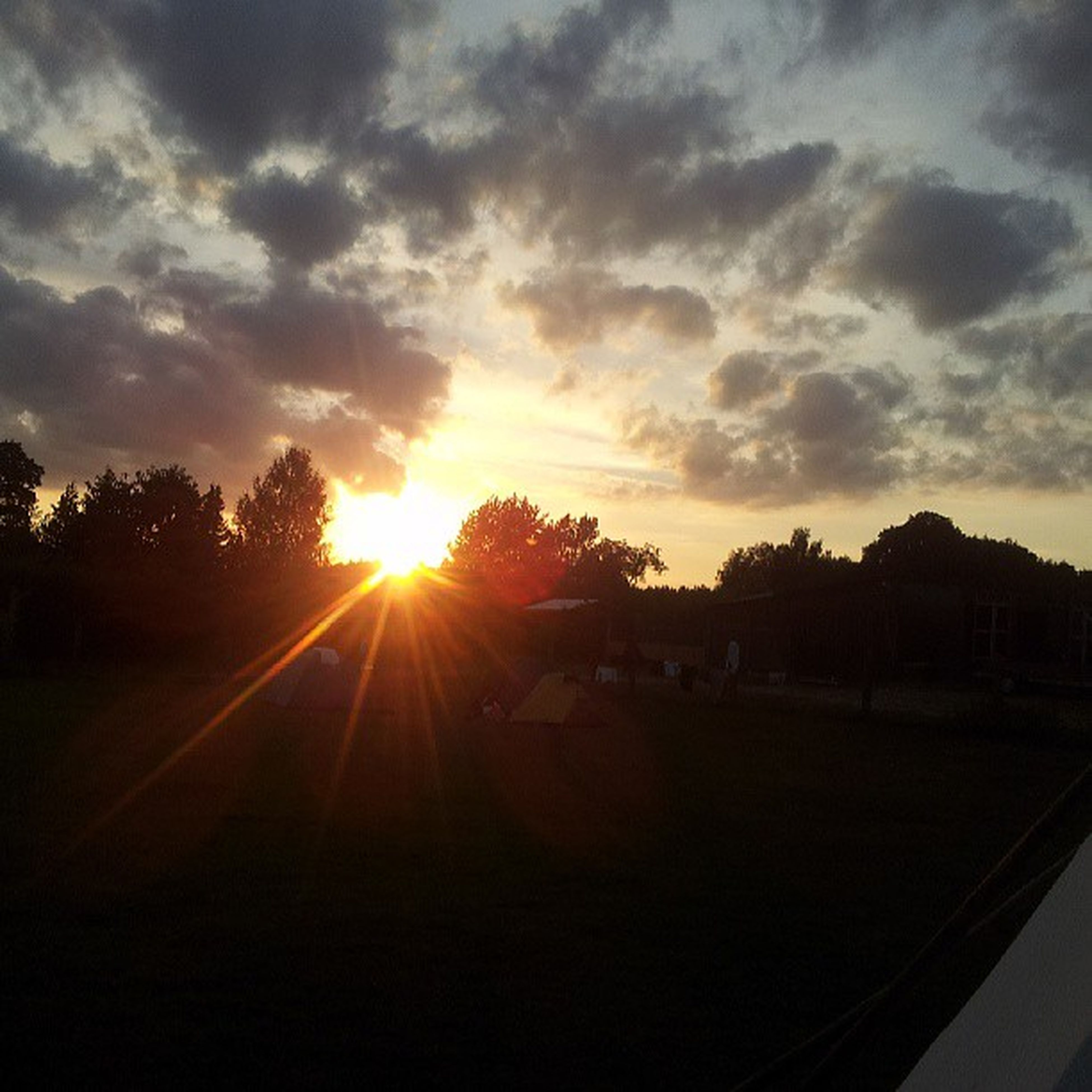 sunset, sun, silhouette, sky, tree, sunbeam, sunlight, tranquil scene, tranquility, scenics, landscape, beauty in nature, cloud - sky, lens flare, orange color, nature, idyllic, field, cloud, outdoors