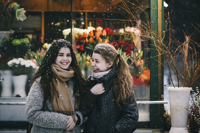 Adult Adults Only Beautiful People Beautiful Woman Beauty Beauty In Nature Cheerful Christmas Christmas Decoration City Cold Temperature Friendship Night Only Young Women Outdoors People Retail  Snow Togetherness Two People Warm Clothing Winter Women Young Adult Young Women