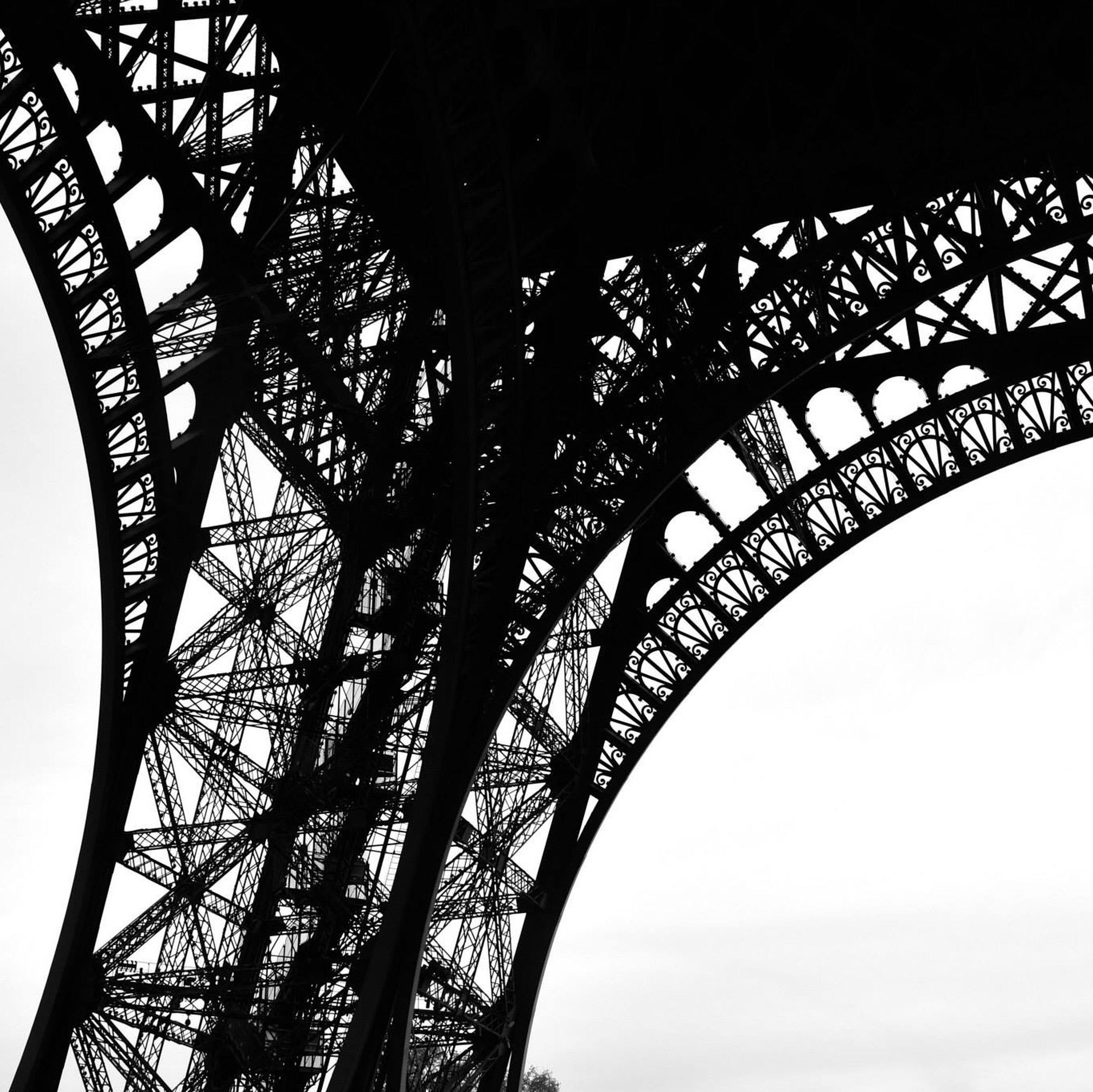 low angle view, built structure, architecture, metal, metallic, engineering, eiffel tower, famous place, international landmark, connection, travel destinations, clear sky, capital cities, architectural feature, culture, tourism, travel, bridge - man made structure, tower, sky
