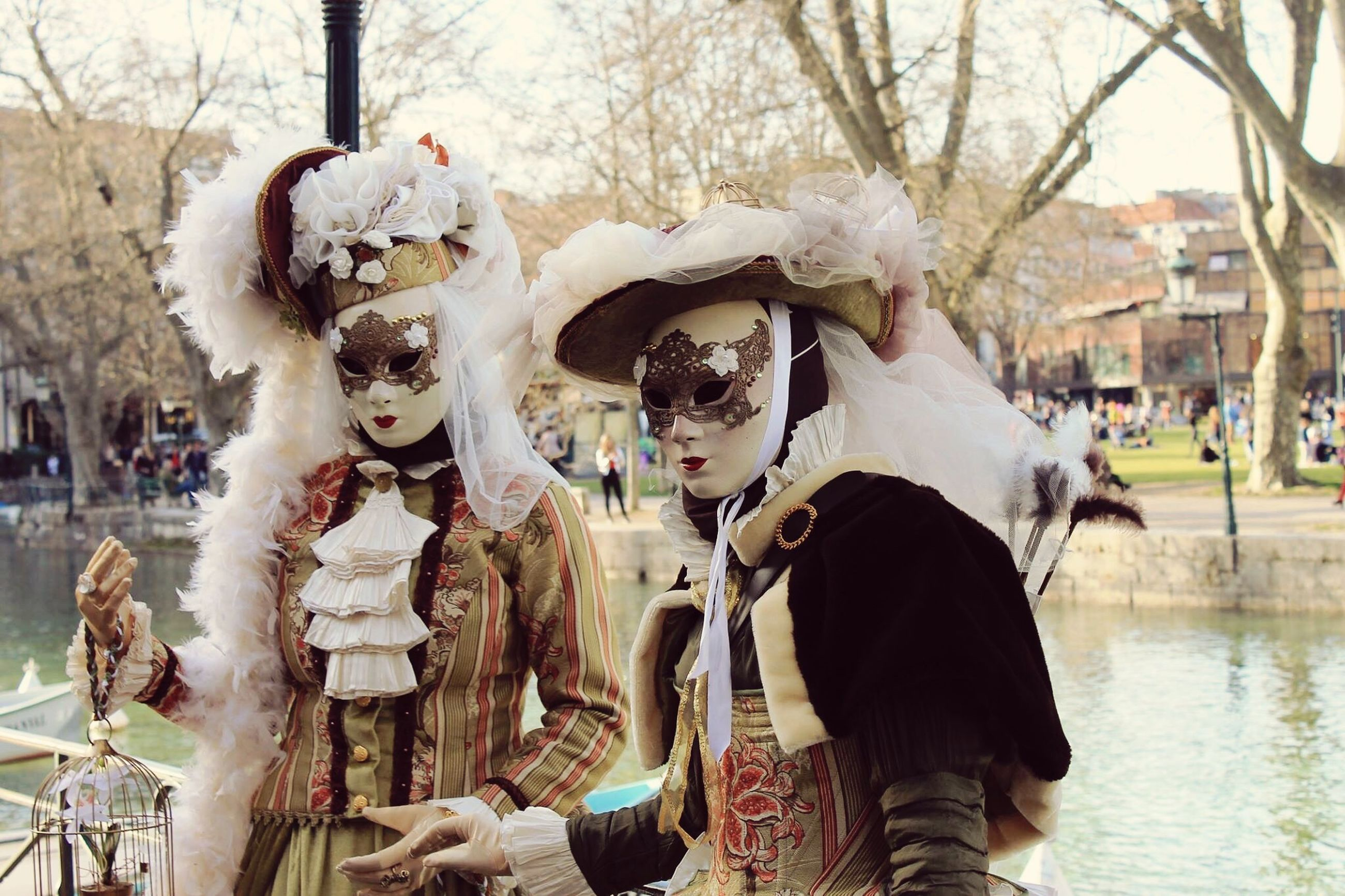 mask - disguise, celebration, cultures, unrecognizable person, venetian mask, outdoors, carnival - celebration event, leisure activity, traditional festival, adults only, people, day, adult