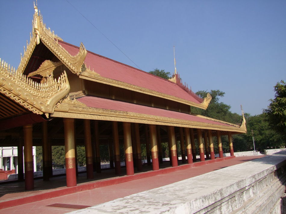 Mya Nan Son Royal Palace Architecture Assembly Hall Blue Sky Buddhism Buddhism Culture Buddhist Architecture Building Exterior Built Structure Composition Full Frame Hall Mandalay Mya Nan Son Royal Palace Myanmar No People Outdoor Photography Palace Red And Gold Colour Royal Palace Sunlight Tourism Tourist Attraction  Tourist Destination Tree