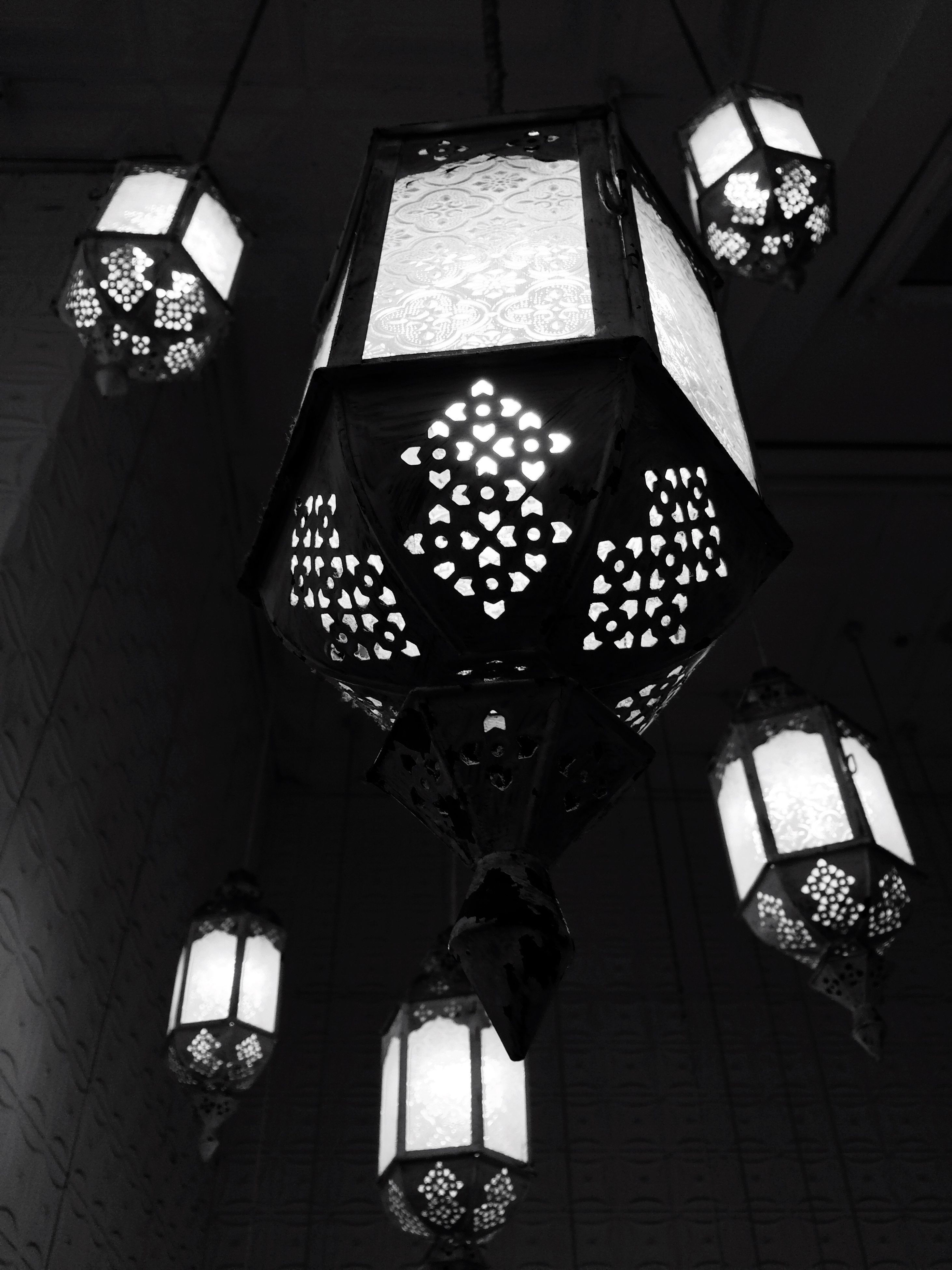indoors, ceiling, low angle view, architecture, built structure, lighting equipment, illuminated, hanging, window, electric light, building, chandelier, electric lamp, no people, pattern, electricity, interior, building exterior, decoration, wall - building feature