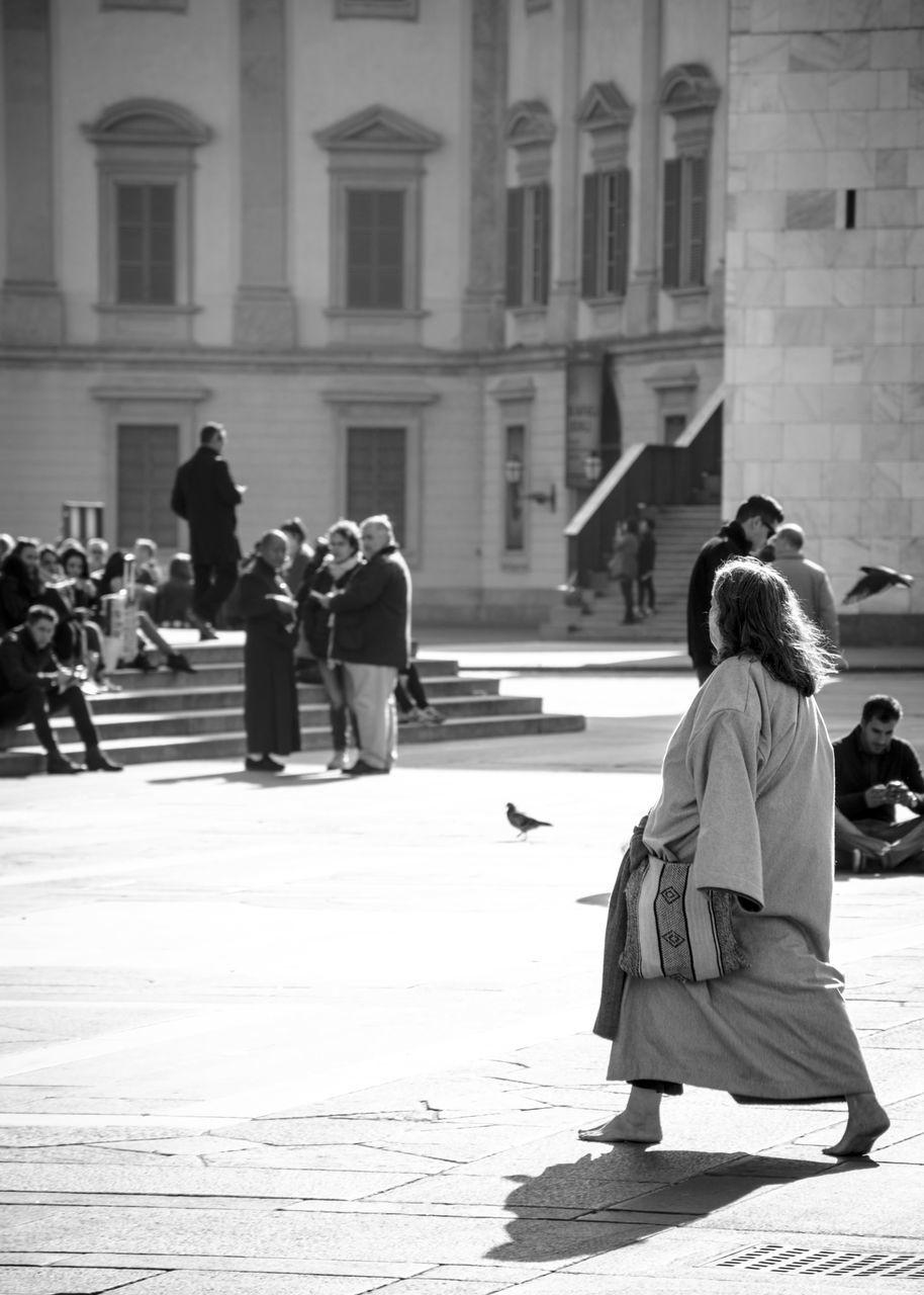 Woman Walking On Street Against Building