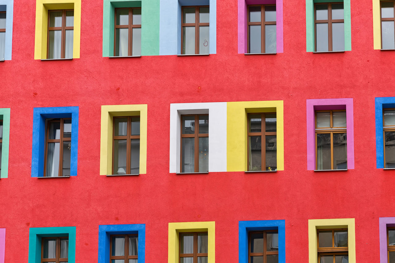 Red colourful facade with multi-coloured window frames Architectural Detail Architecture Architecture Architecture_collection Backgrounds Building Exterior Built Structure City Facade Building Facades Façade Full Frame Lines Lines And Shapes Multi Colored No People Outdoors Red Red Residential Building Window
