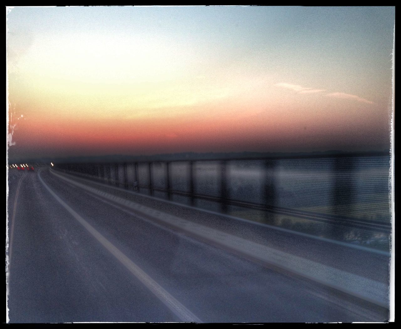 sunset, road, transportation, sky, sun, no people, scenics, nature, outdoors, tranquil scene, tranquility, sunlight, beauty in nature, sea, clear sky, water, day
