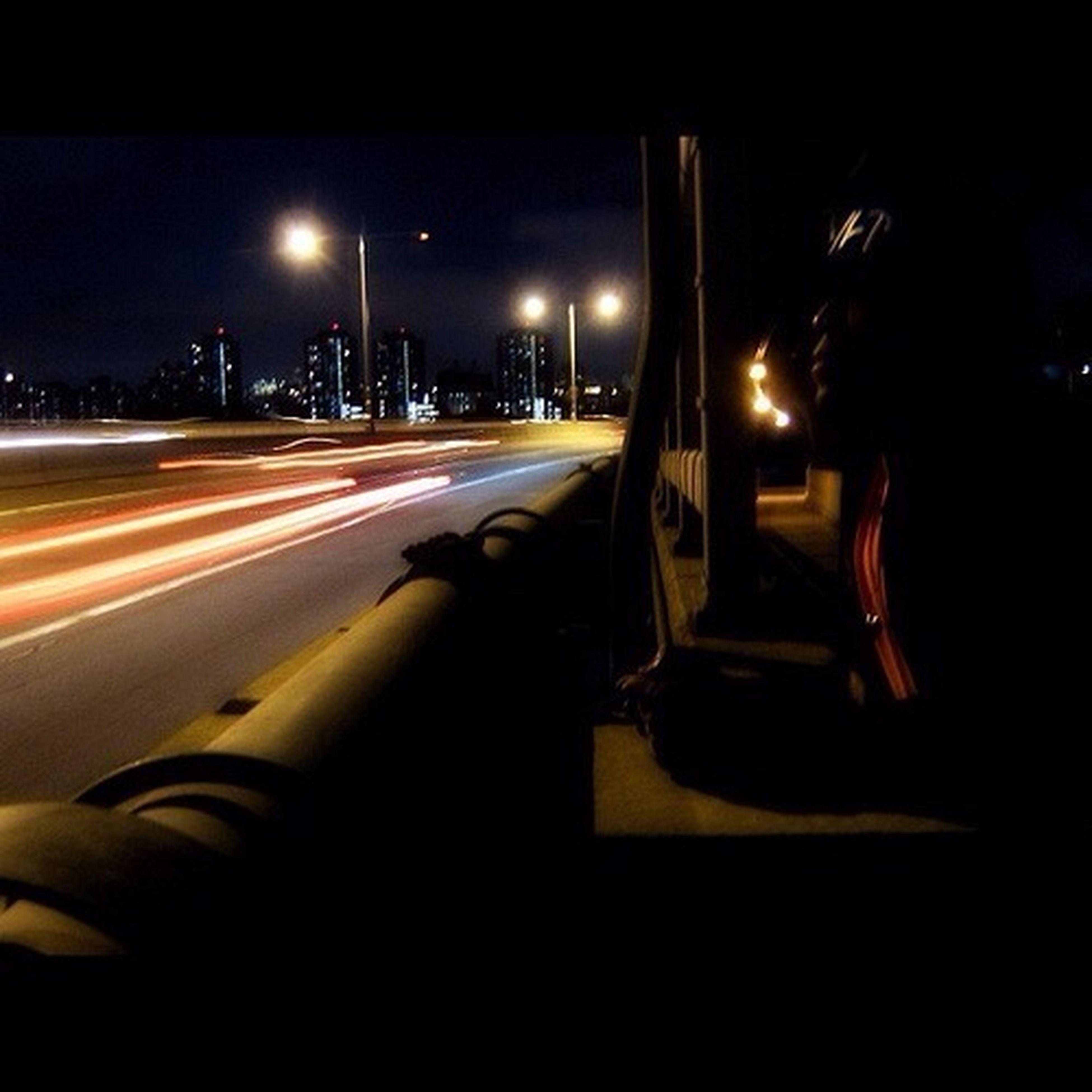 illuminated, night, transportation, street light, car, road, land vehicle, street, mode of transport, long exposure, light trail, motion, speed, on the move, traffic, sky, lighting equipment, road marking, blurred motion, city