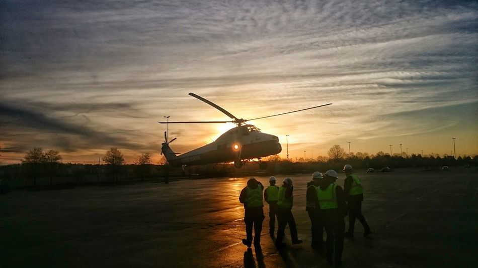Helicopter touchdown at sunrise at concord mills mall in Concord, NC Teamwork People Helicopter Helicopter 🚁 Sunrise Silhouette Men At Work  Helicopter In Action Helicopter Parking Helicopter Landing