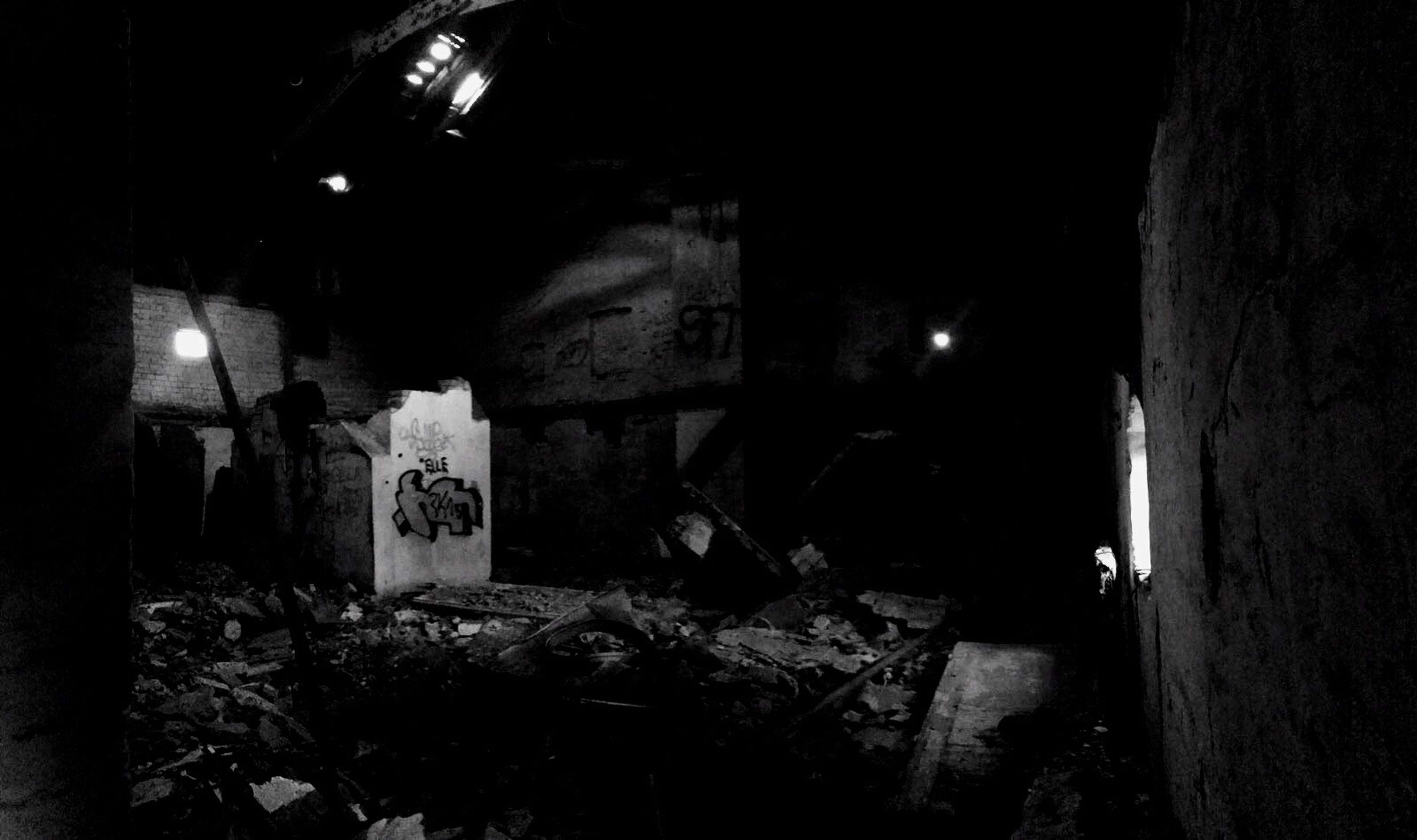 night, abandoned, illuminated, built structure, architecture, old, obsolete, damaged, run-down, building exterior, wall - building feature, deterioration, weathered, graffiti, outdoors, dark, building, no people, plant, messy