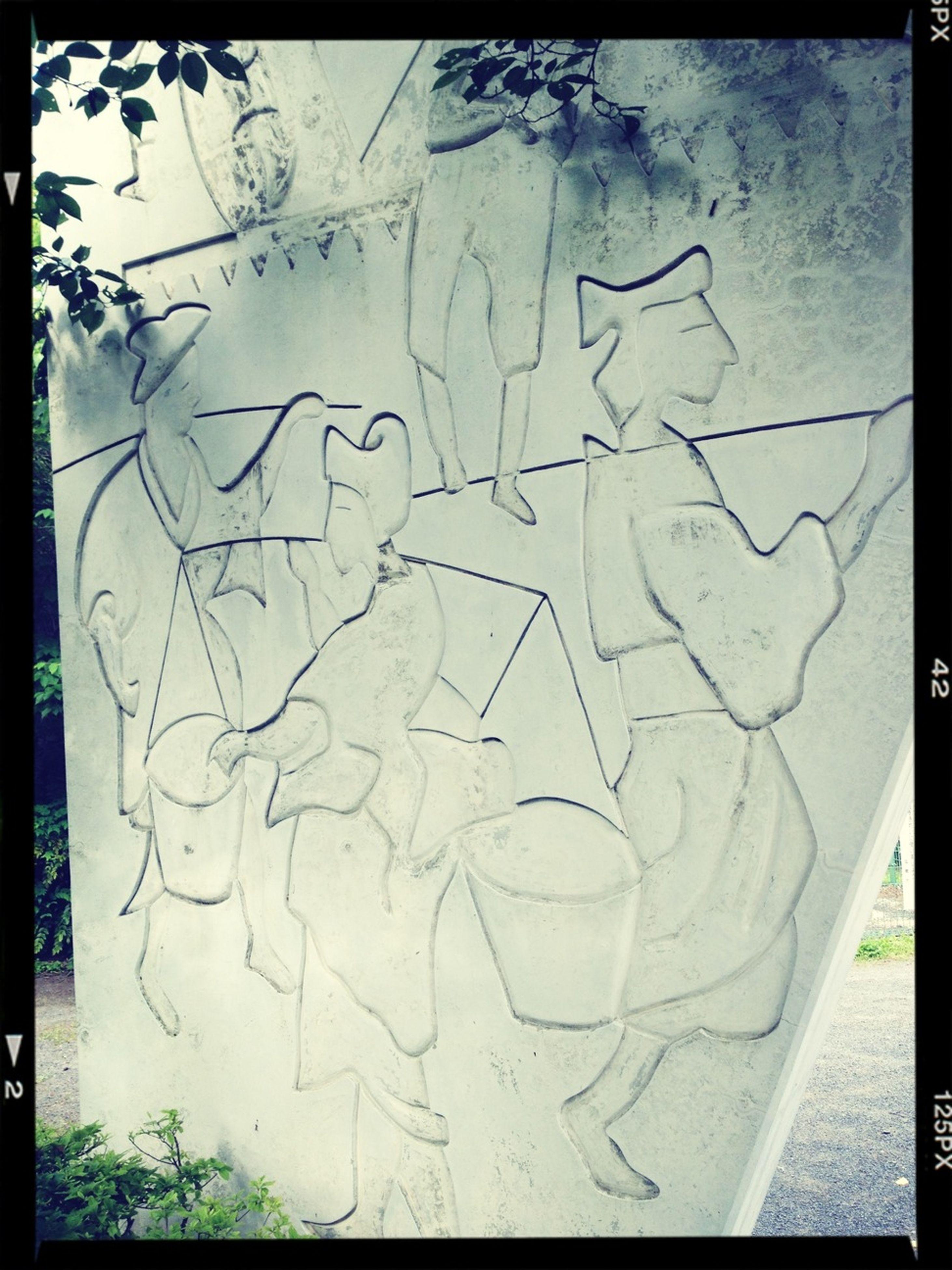 transfer print, auto post production filter, creativity, art, graffiti, art and craft, text, western script, wall - building feature, close-up, communication, wall, human representation, paint, day, heart shape, textured, ideas, outdoors, love