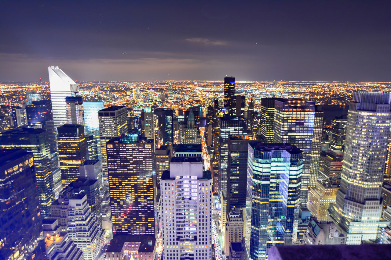 architecture, cityscape, city, building exterior, skyscraper, crowded, illuminated, modern, night, built structure, travel destinations, aerial view, outdoors, tall, sky