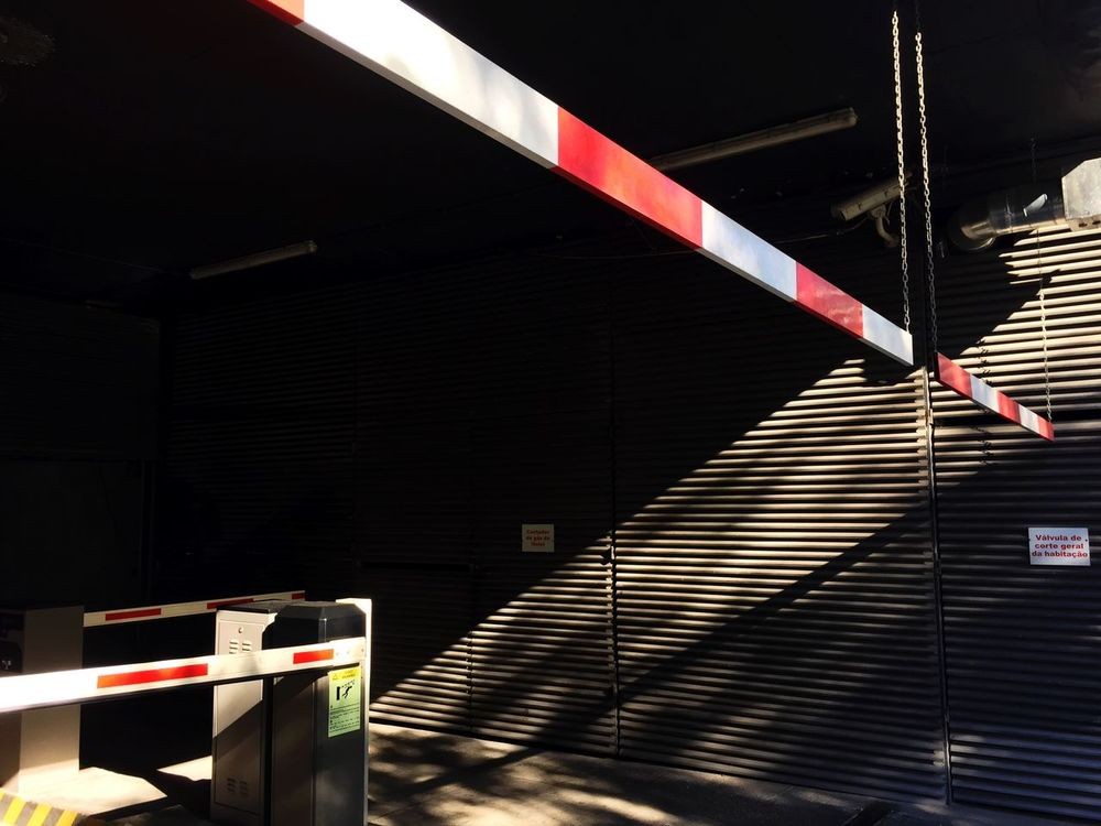 Striped Built Structure Cordon Tape Illuminated No People Architecture Outdoors Staircase Parking Garage Day Outdoor Photography Building Exterior Red And White Entrance Black Wall Lines Textures And Surfaces