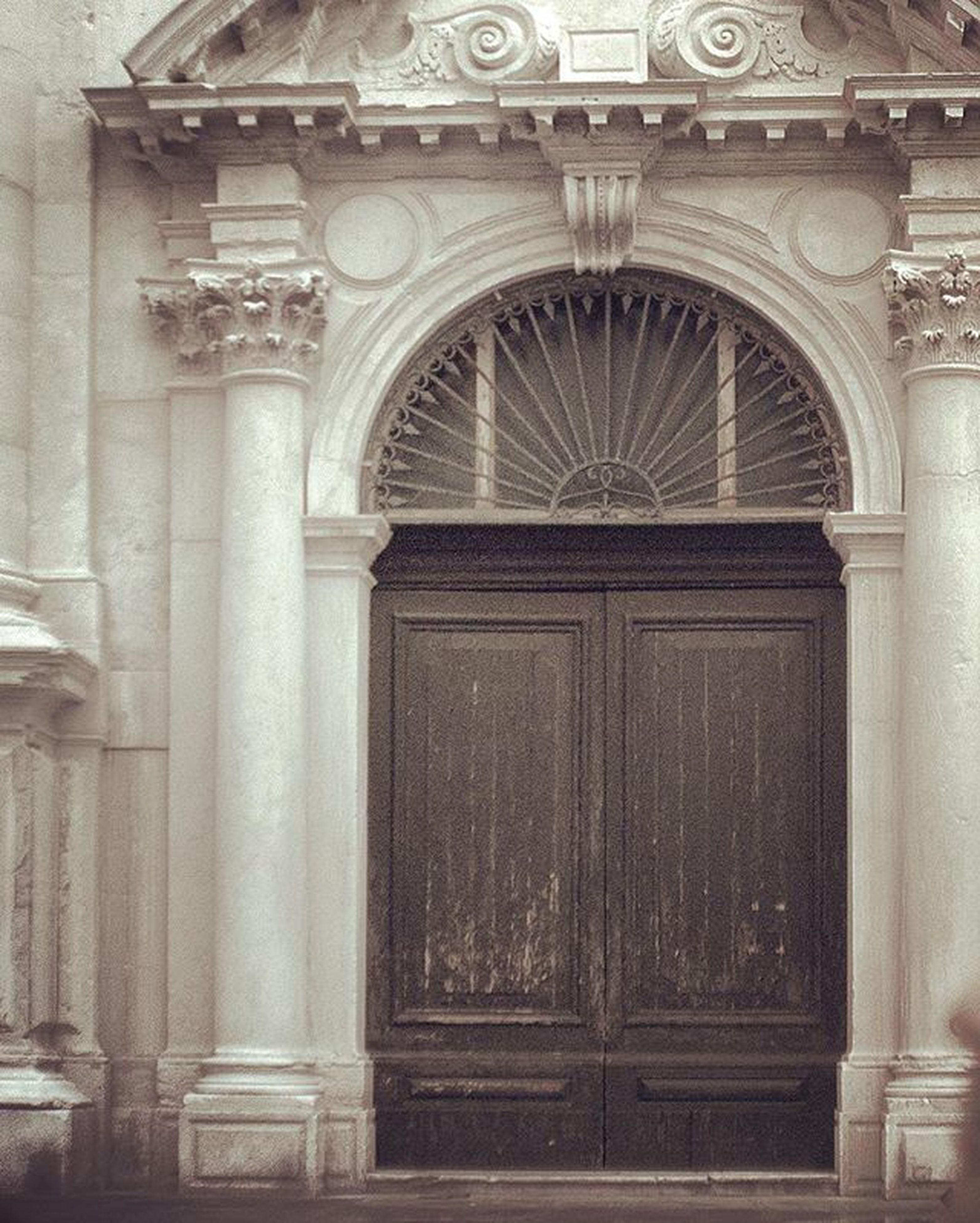 architecture, door, built structure, building exterior, entrance, arch, closed, old, window, facade, history, ornate, doorway, wood - material, architectural column, day, gate, art and craft, safety, no people