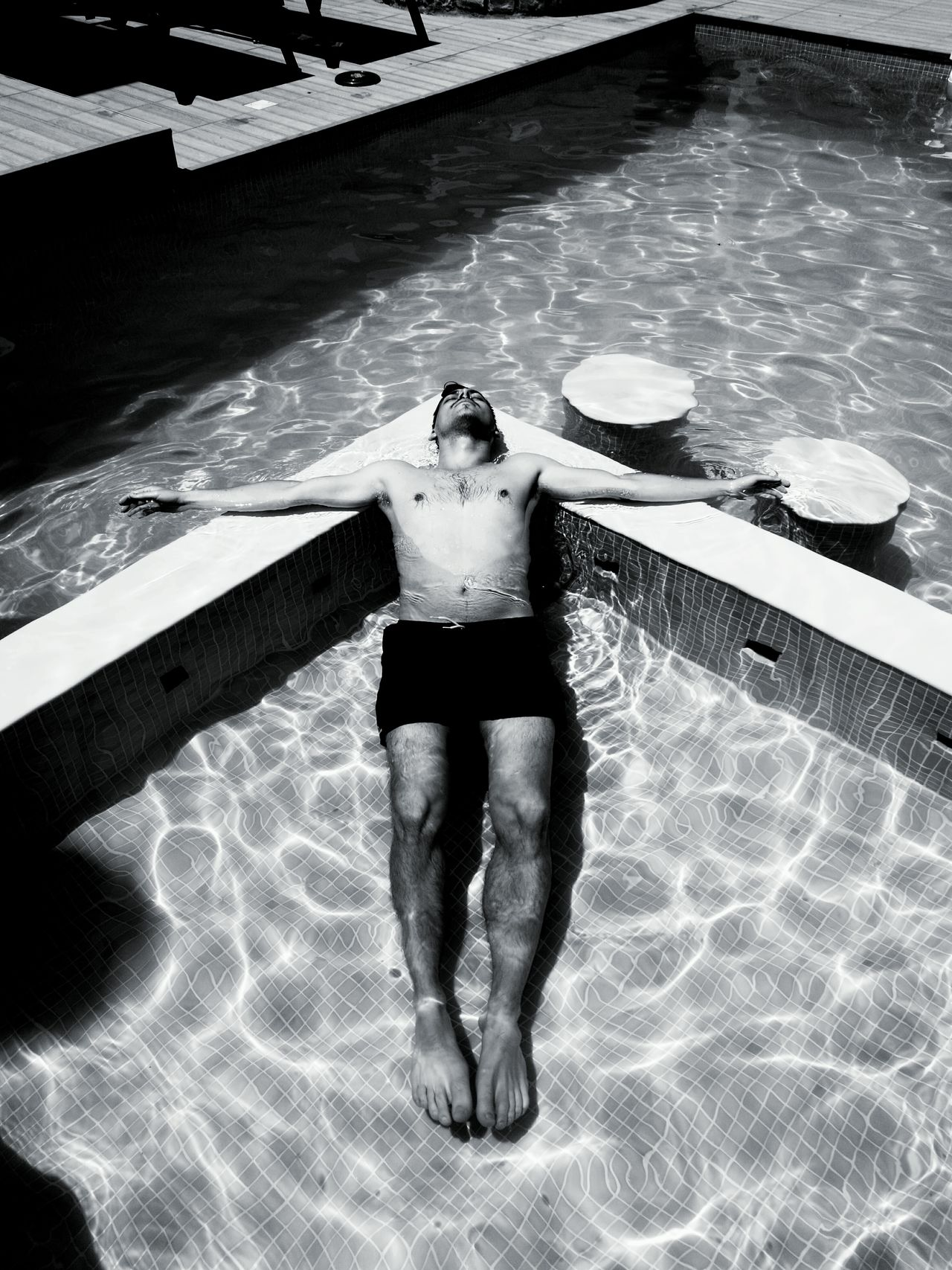 Summer Water One Person Lifestyles Adult Vacations Black And White Bodyart Life Is Beautiful Swiming Pool Resting Relax Time  Life Is A Beach Blackandwhite Photography Pool Time Young Man Beautiful Day