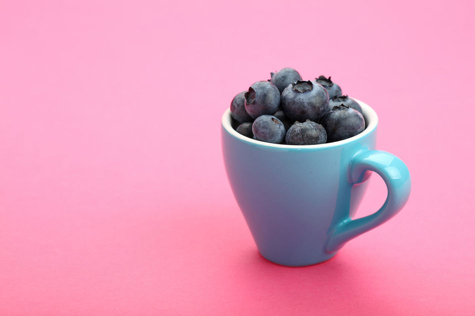 Cup of fresh blueberries over pink paper Background Berry Berry Fruit Blueberries Blueberry Bowl Breakfast Cup Dessert Diet Diet & Fitness Feminine  Food Food And Drink Freshness Fruit Healthy Healthy Eating Healthy Food Pastel Pastel Colors Pink Ready To Eat Vegetarian Food