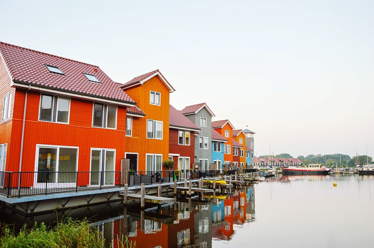 Colourfull houses Colour Of Life Reitdiephaven Reitdiep Haven Reitdiep Groningen Hanzehogeschool Haven Harbor Lake House  Red Orange Residential  Waterfront Dutch Dutch Architecture Reflection Water
