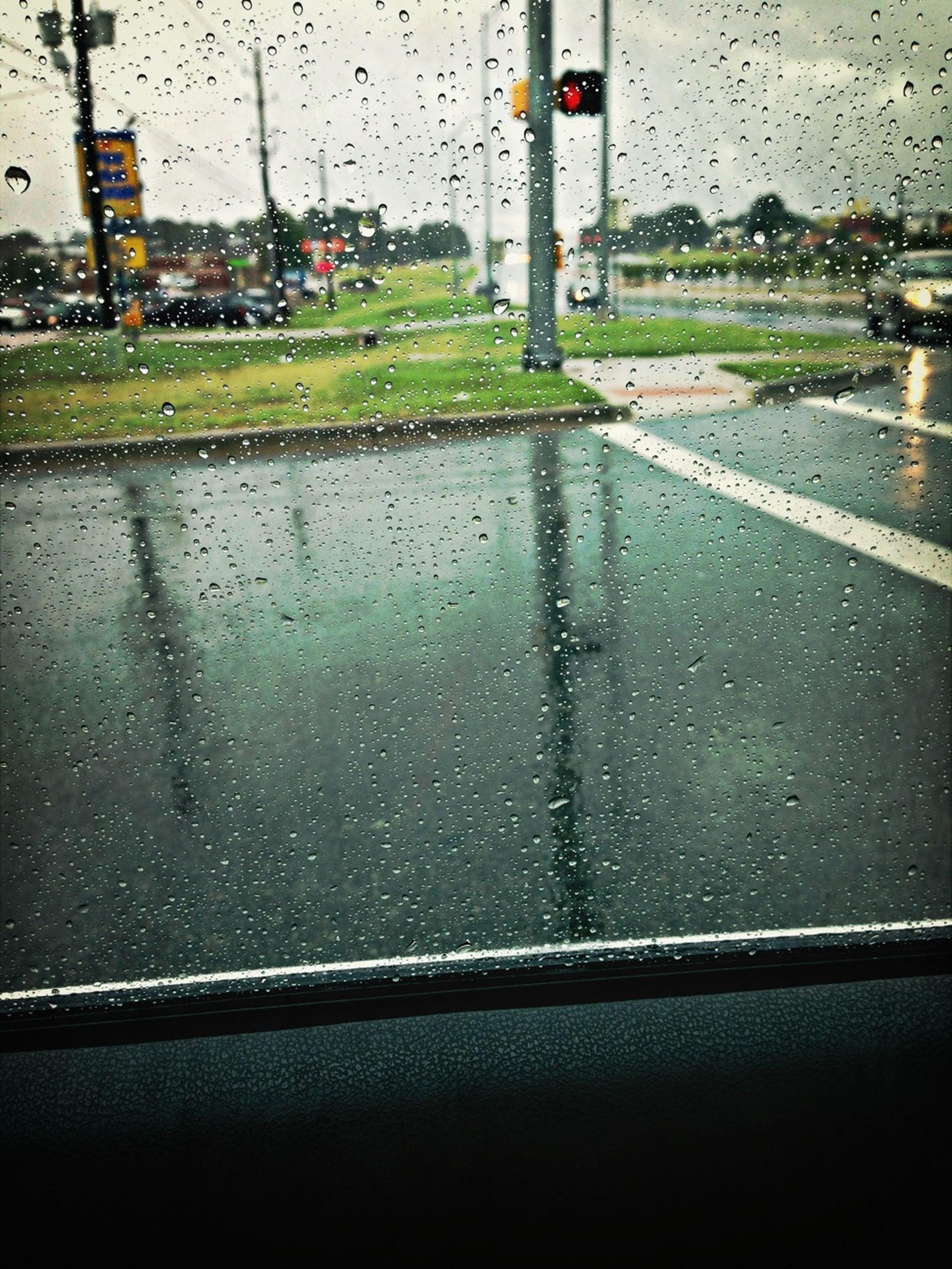 transportation, wet, window, rain, drop, transparent, glass - material, mode of transport, car, water, land vehicle, vehicle interior, raindrop, season, weather, road, street, indoors, windshield, glass