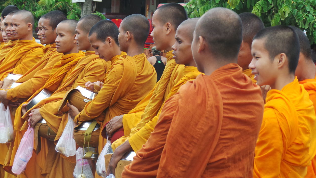 Boys Buddhist Buddhist Monks Cambodia Culture And Tradition Cultures Group Of People Lifestyle Monks Orange Orange Color Religion Robe Robes Shaved Heads Standing Yellow Young Adult Friends Smiles