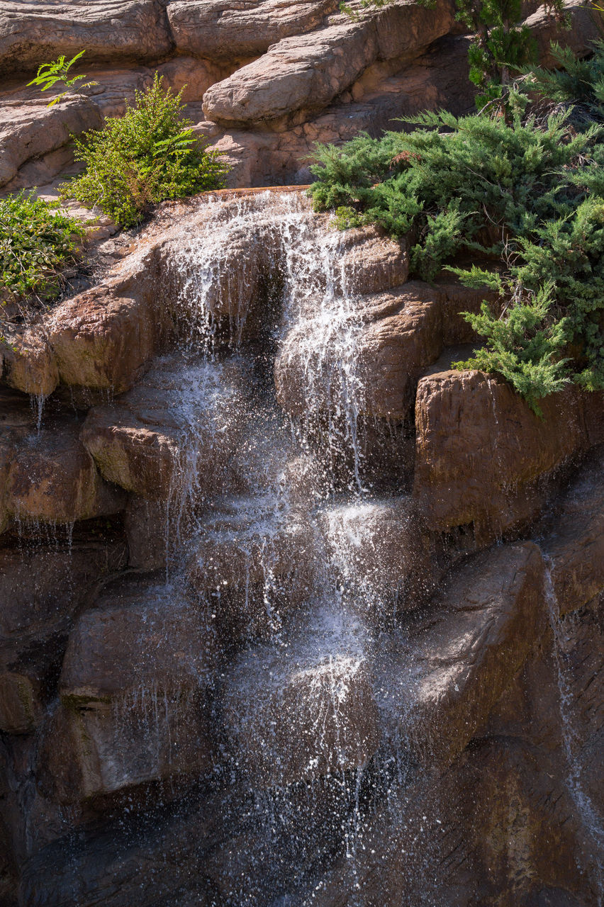 waterfall, rock - object, motion, rock formation, water, nature, scenics, long exposure, cliff, beauty in nature, no people, outdoors, day, river, tree, travel destinations, rapid, power in nature, rock face, sky