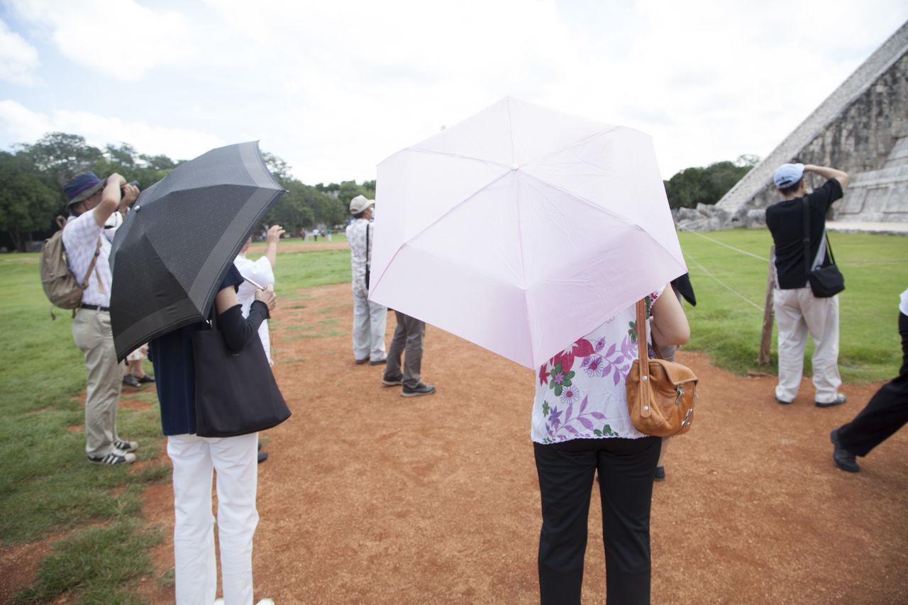 Beautiful stock photos of umbrella, Adult, Day, Full Length, Ground