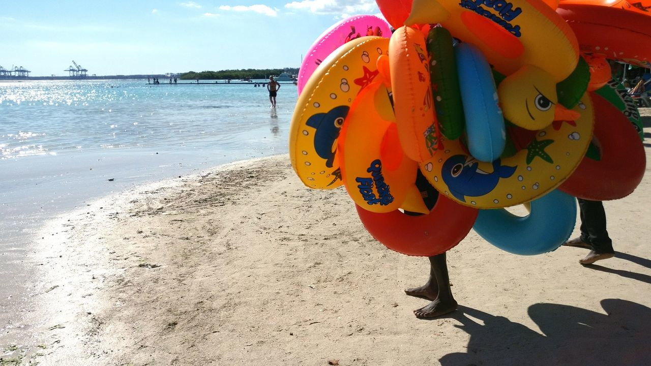 Beach Sea Sand Outdoors Nature Water No People Ball Close-up Day Sand Pail And Shovel Caribean Sea Horizon Over Water Rubber Duck Rubber Toys Rubber Rings Seller On Beach Colorful Feet Toys Toyseller Inflated Toys Inflatables
