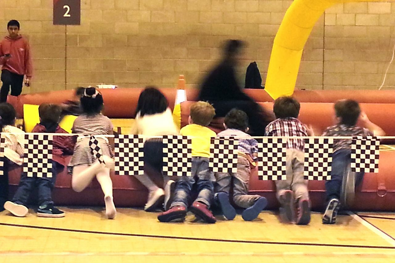 indoors, real people, men, women, togetherness, yellow, lifestyles, education, sitting, leisure activity, full length, large group of people, playing, day, student, people