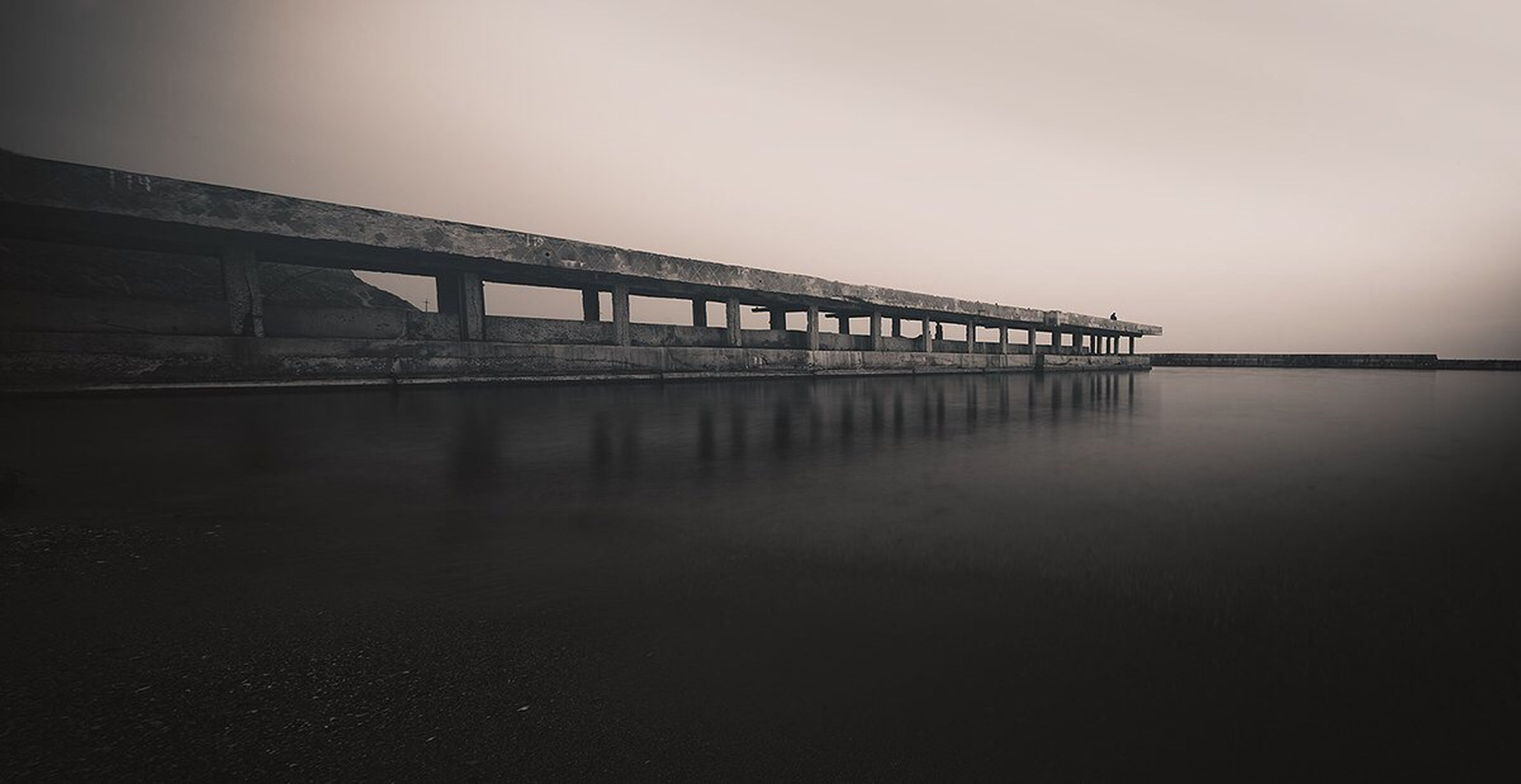 water, built structure, architecture, sea, bridge - man made structure, connection, copy space, clear sky, bridge, sky, reflection, sunset, waterfront, tranquility, tranquil scene, dusk, pier, nature, scenics, river