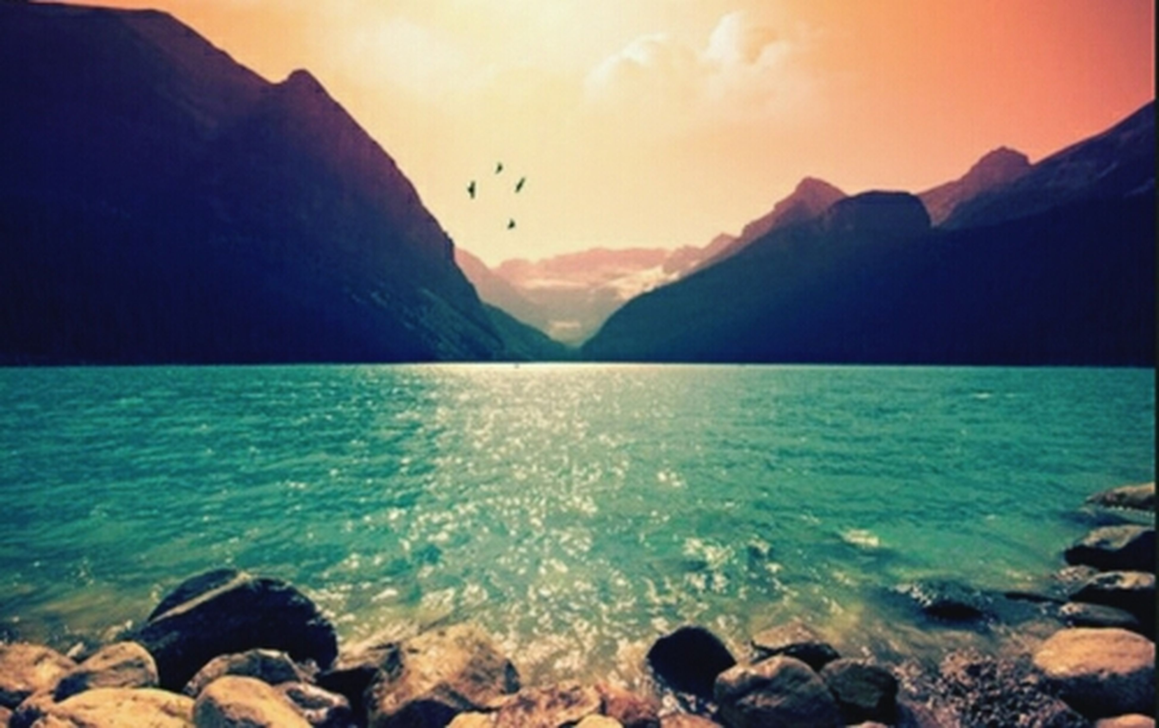 water, sea, mountain, scenics, tranquil scene, beauty in nature, tranquility, rock - object, sky, nature, idyllic, mountain range, rock, rock formation, shore, bird, silhouette, sunset, non-urban scene, outdoors