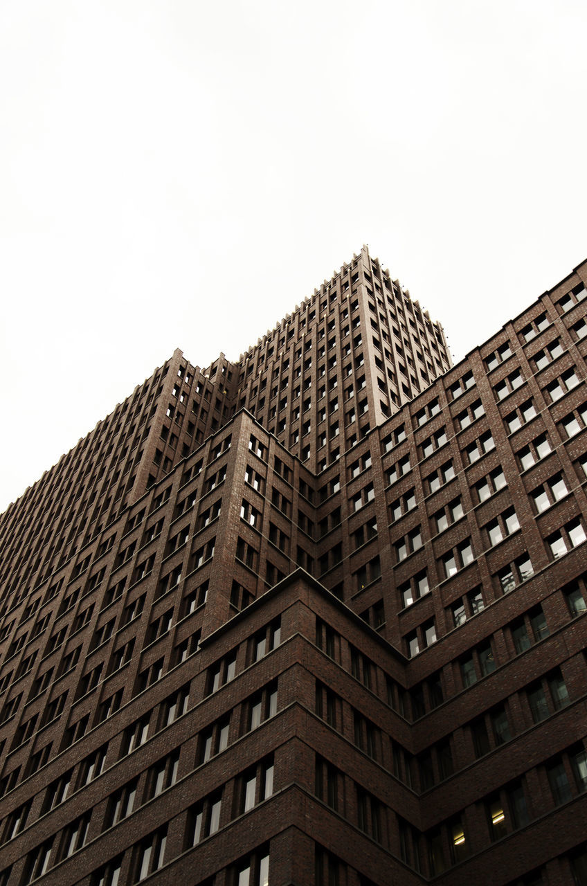 architecture, building exterior, low angle view, skyscraper, built structure, no people, modern, tall, outdoors, day, city, clear sky, sky