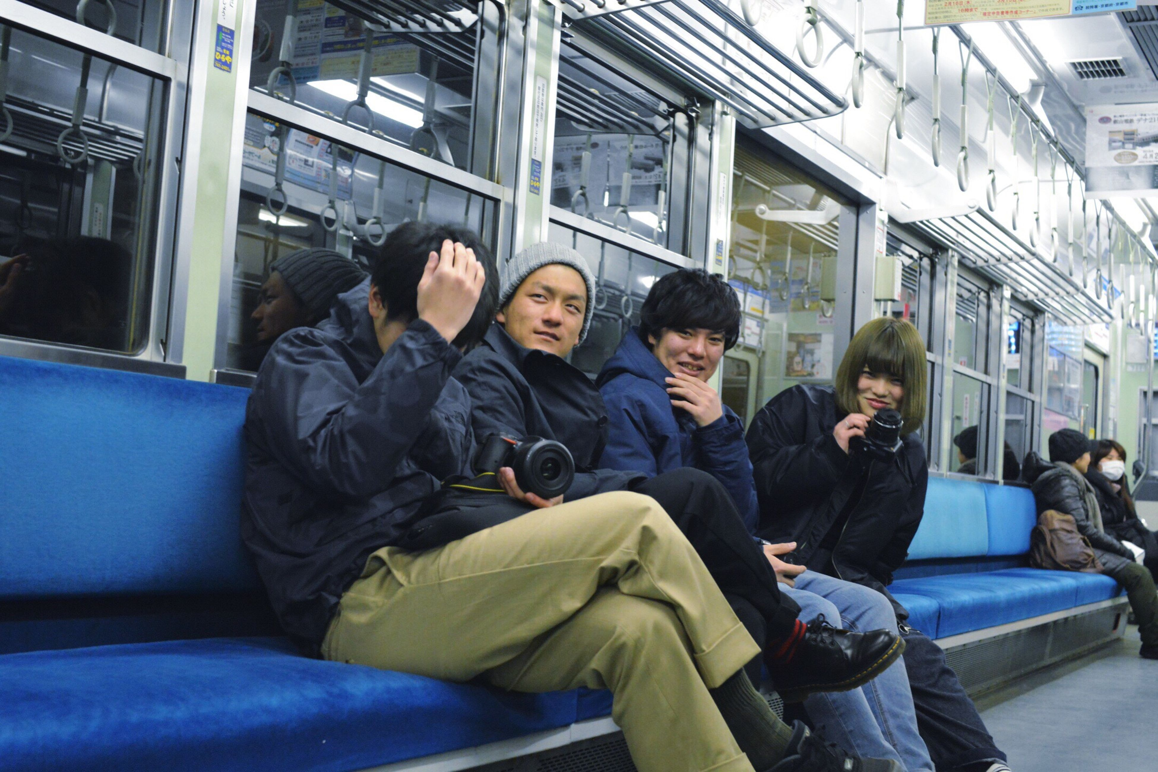 subway train, train - vehicle, indoors, travel, casual clothing, sitting, public transportation, adults only, people, adult, commuter, only men, men, human body part, young adult, day