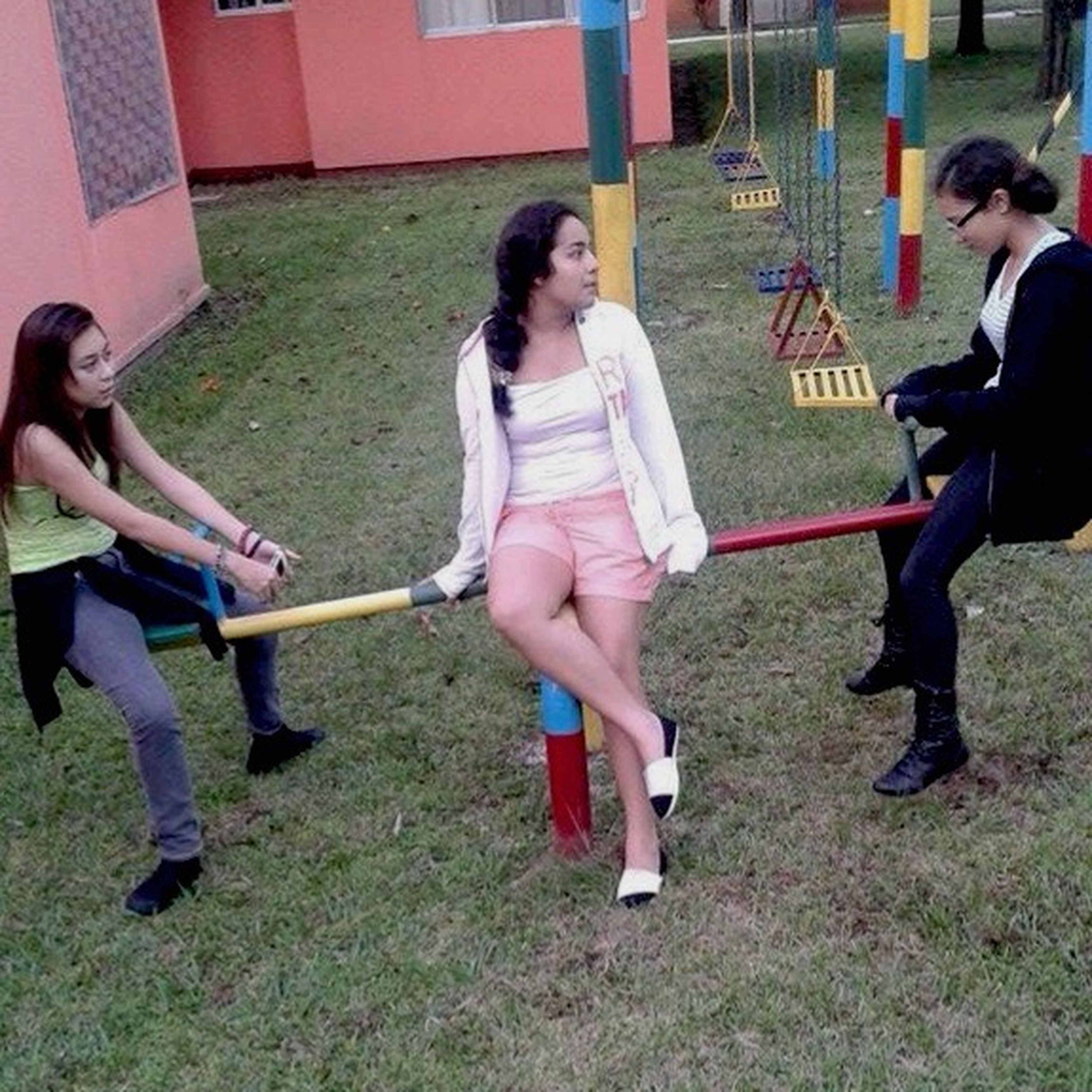 lifestyles, grass, leisure activity, full length, casual clothing, person, childhood, playing, holding, fun, happiness, young adult, park - man made space, enjoyment, sport, field, elementary age, boys