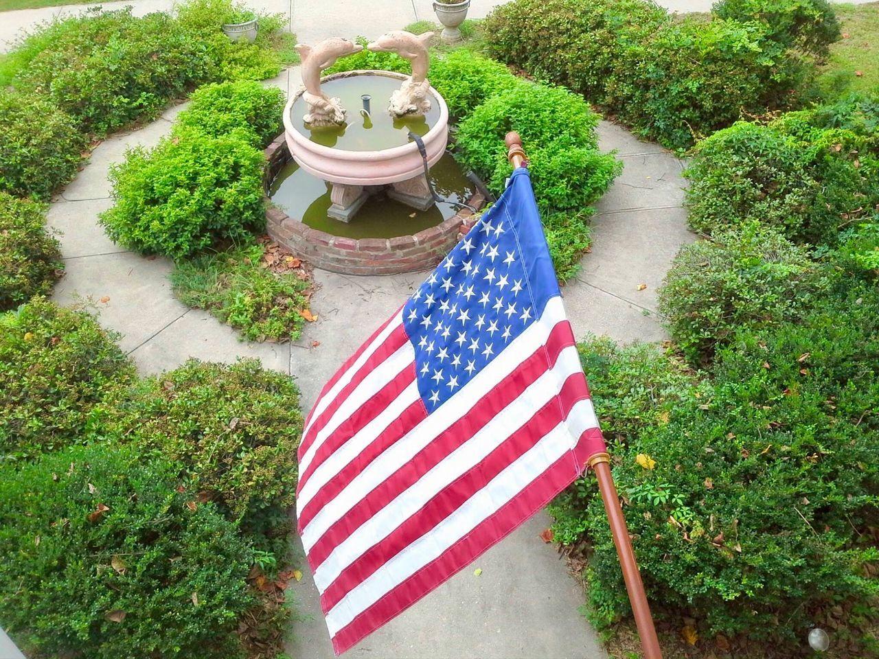 American flag over USA garden Balcony Shot Fountains Fountain_collection Fountain Garden Garden Photography Garden Architecture Garden_world Fountain Fun Dolphin Dolphinlover High Angle View American Flag