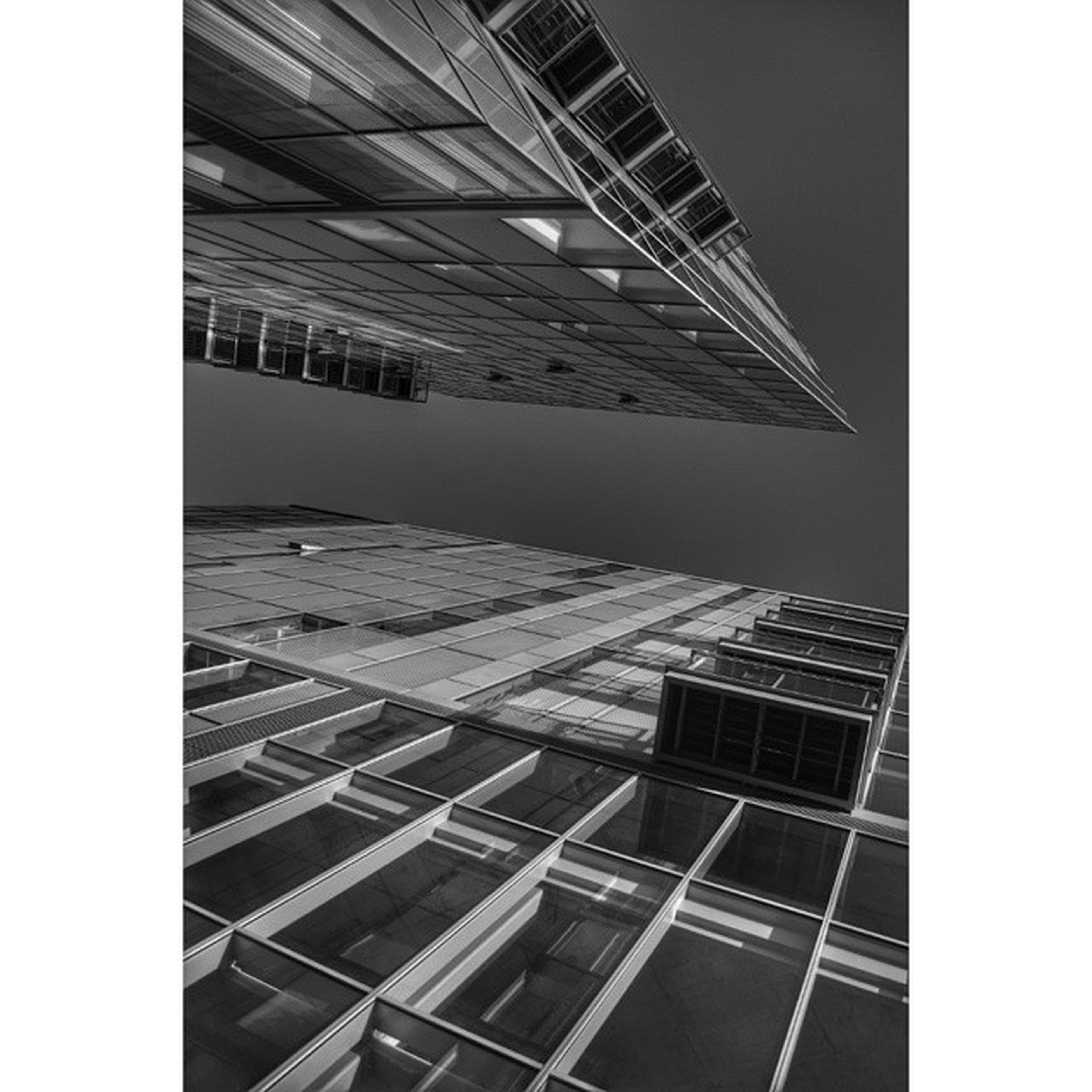 transfer print, auto post production filter, architecture, built structure, building exterior, low angle view, modern, city, building, office building, day, clear sky, pattern, no people, glass - material, outdoors, tall - high, skyscraper, sky, sunlight