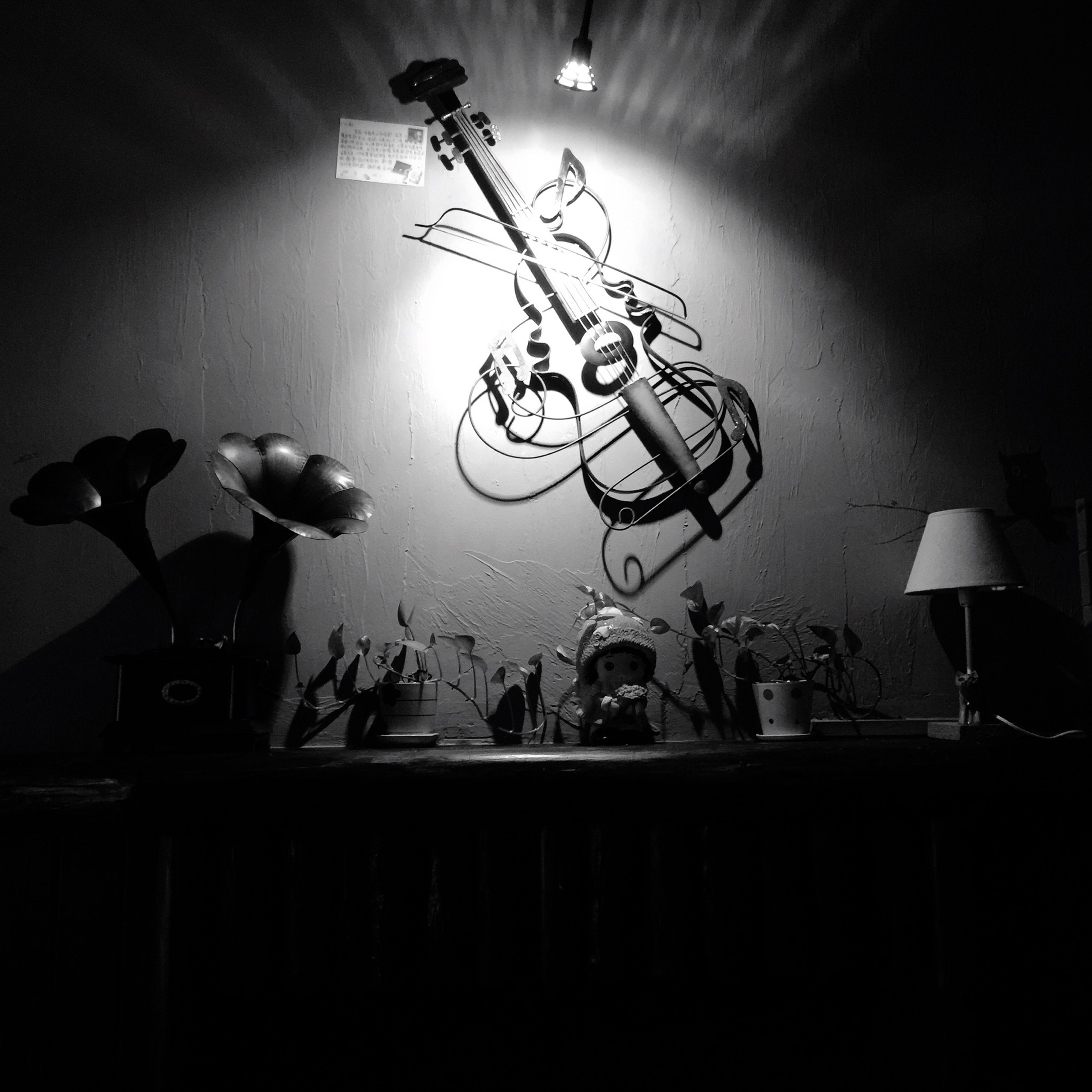 indoors, lighting equipment, illuminated, electricity, low angle view, hanging, electric lamp, electric light, ceiling, built structure, light bulb, street light, decoration, architecture, home interior, silhouette, wall - building feature, lamp, no people, night