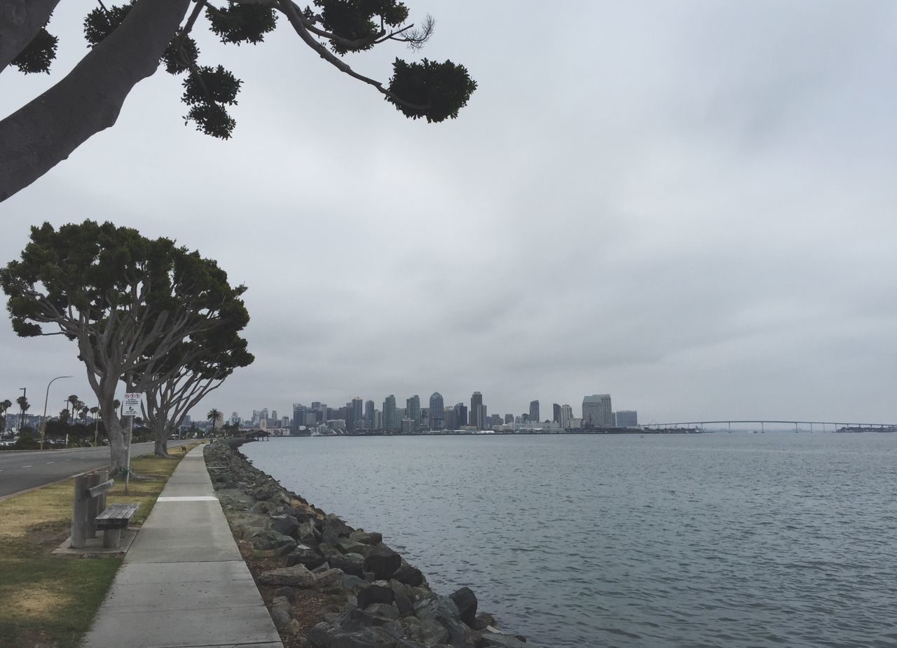 Scenic View Of Sea And City Against Sky