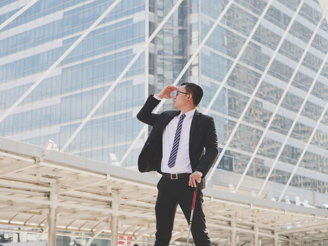 One Man Only Only Men Businessman Business One Person Adults Only Standing Adult Well-dressed Communication Wireless Technology Men People Using Phone Mobile Phone Holding Day Answering Corporate Business Outdoors