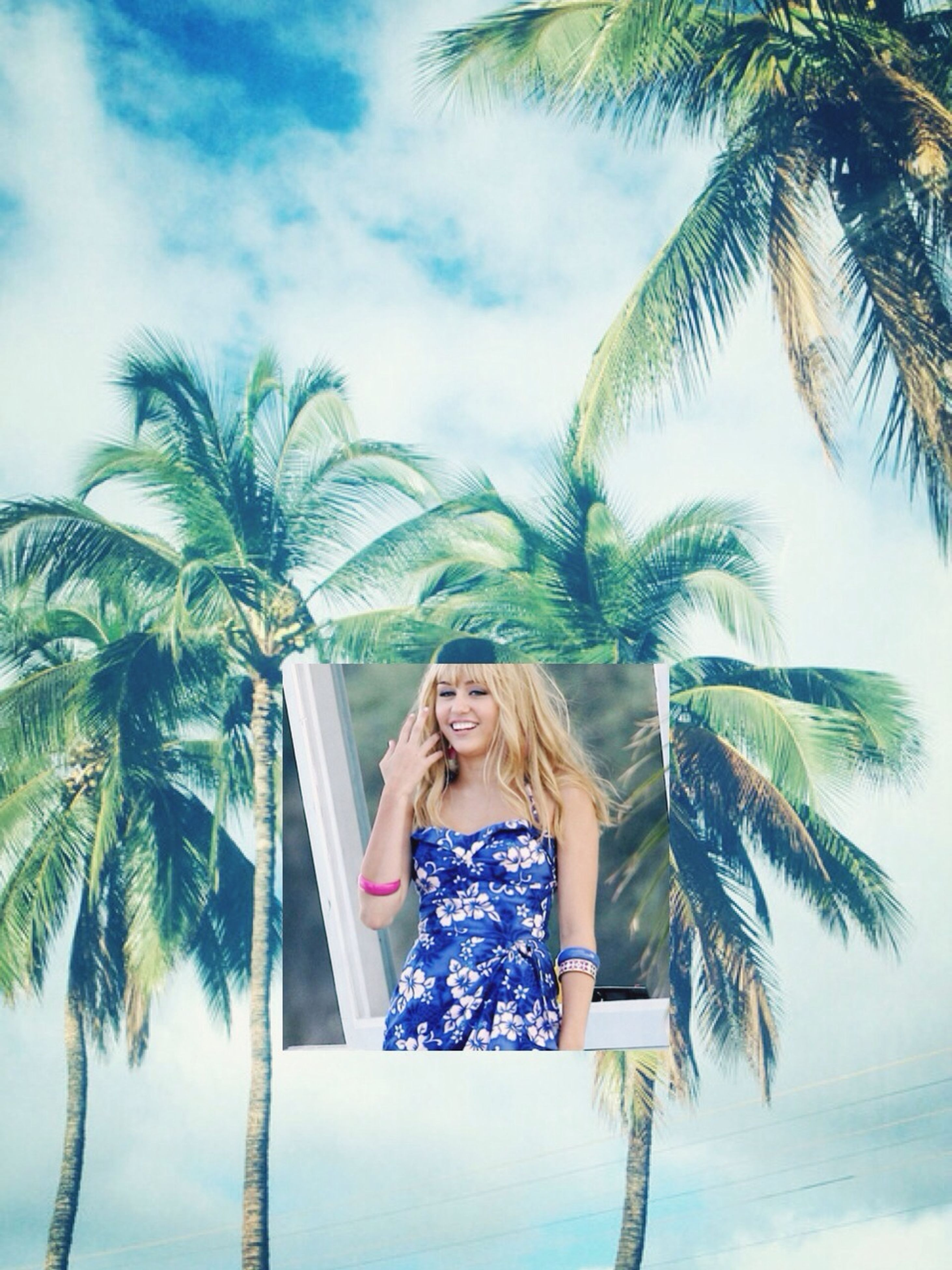 palm tree, tree, sky, person, young adult, lifestyles, leisure activity, young women, low angle view, beach, looking at camera, nature, front view, growth, tranquility, day, standing, long hair