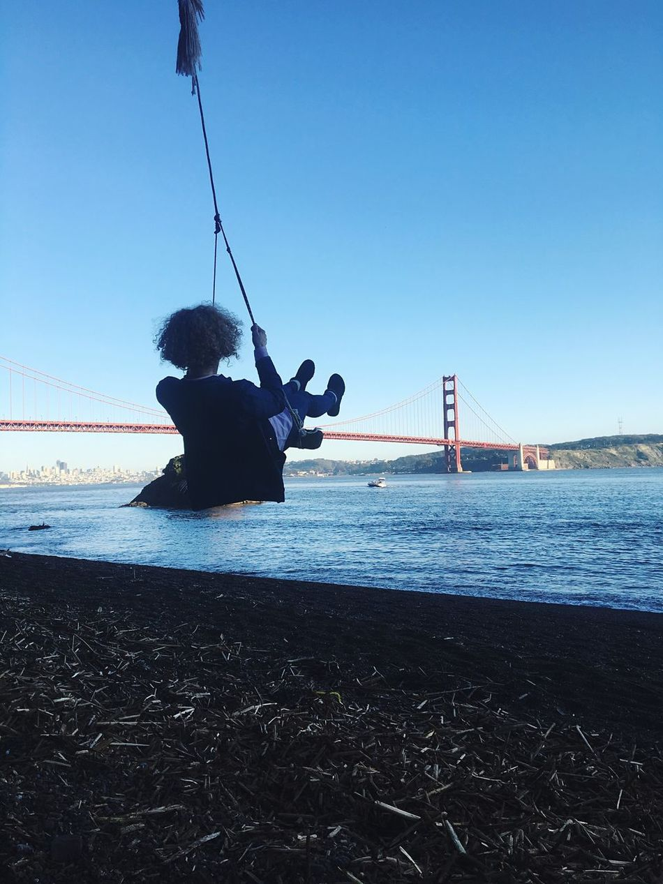 IPhone Photography Iphonephotography IPhoneography Golden Gate Bridge Curly Hair Girl Swing Water Real People Suspension Bridge Bridge - Man Made Structure Transportation Sea Connection One Person Leisure Activity Sky Lifestyles Clear Sky Outdoors Built Structure Day Nautical Vessel Architecture Nature Full Length Travel Destinations The Secret Spaces