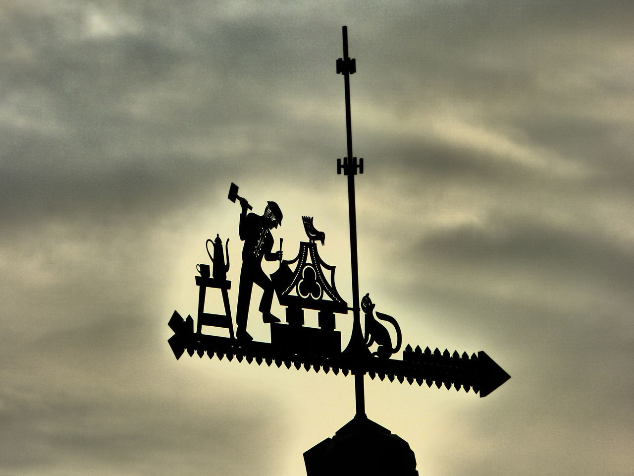 cloud - sky, sky, silhouette, direction, low angle view, statue, outdoors, weather vane, no people, sculpture, day, architecture, sunset, built structure, building exterior