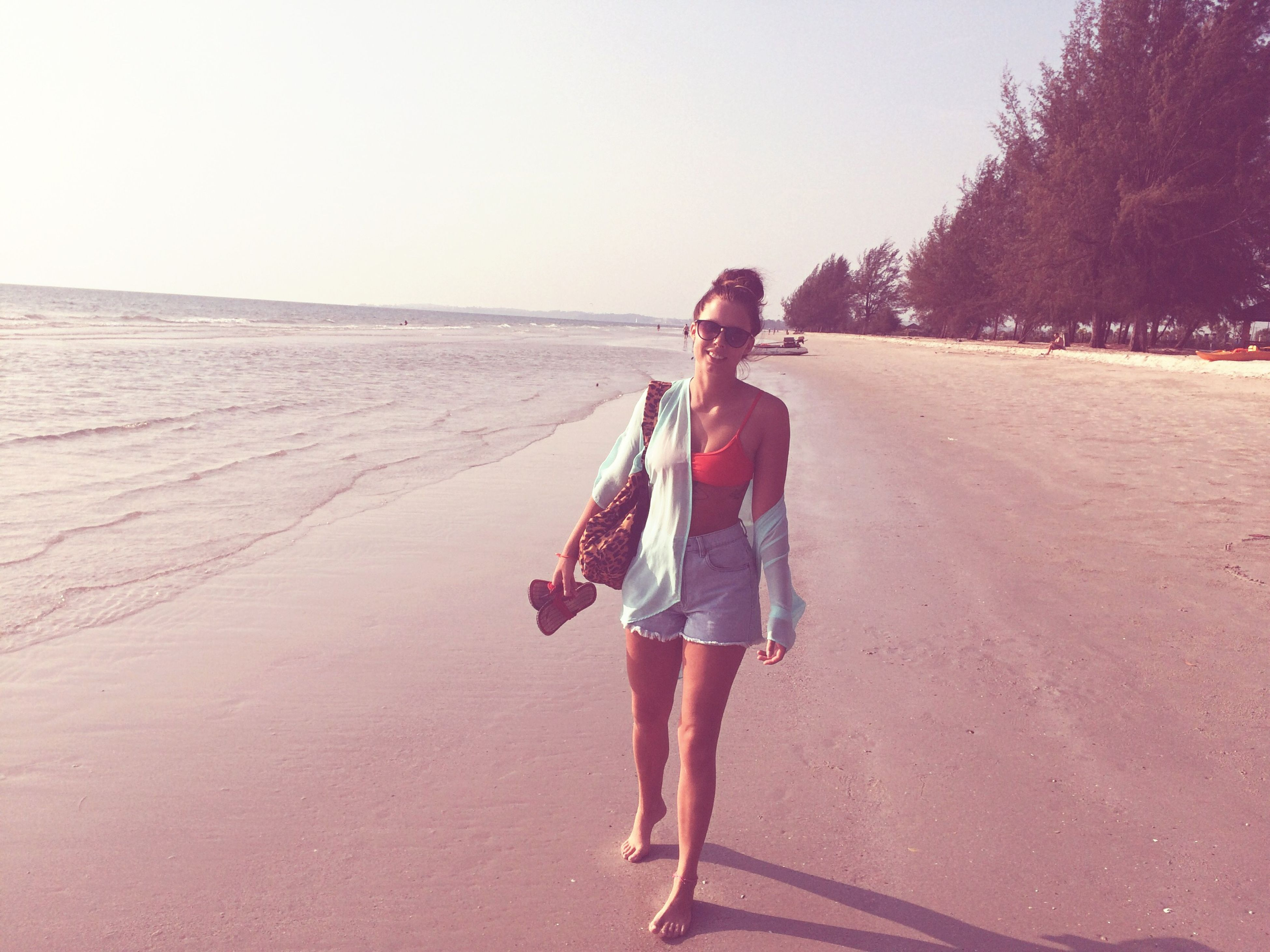 full length, lifestyles, casual clothing, leisure activity, young adult, standing, person, rear view, young women, front view, walking, beach, clear sky, sand, day, copy space, road, outdoors