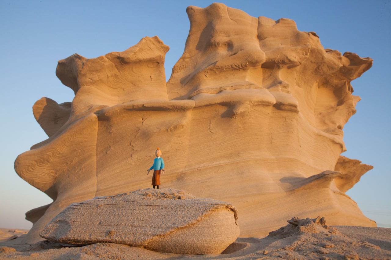 Adventure Arid Climate Beauty In Nature Clear Sky Day Full Length Leisure Activity Lifestyles Low Angle View Nature One Person Outdoors Physical Geography Real People Rock - Object Rock Formation Scenics Sculpture Sky Standing Statue Sunlight Tourism Travel Travel Destinations