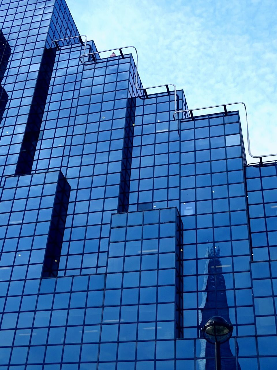 architecture, built structure, building exterior, low angle view, day, outdoors, blue, modern, sky, no people
