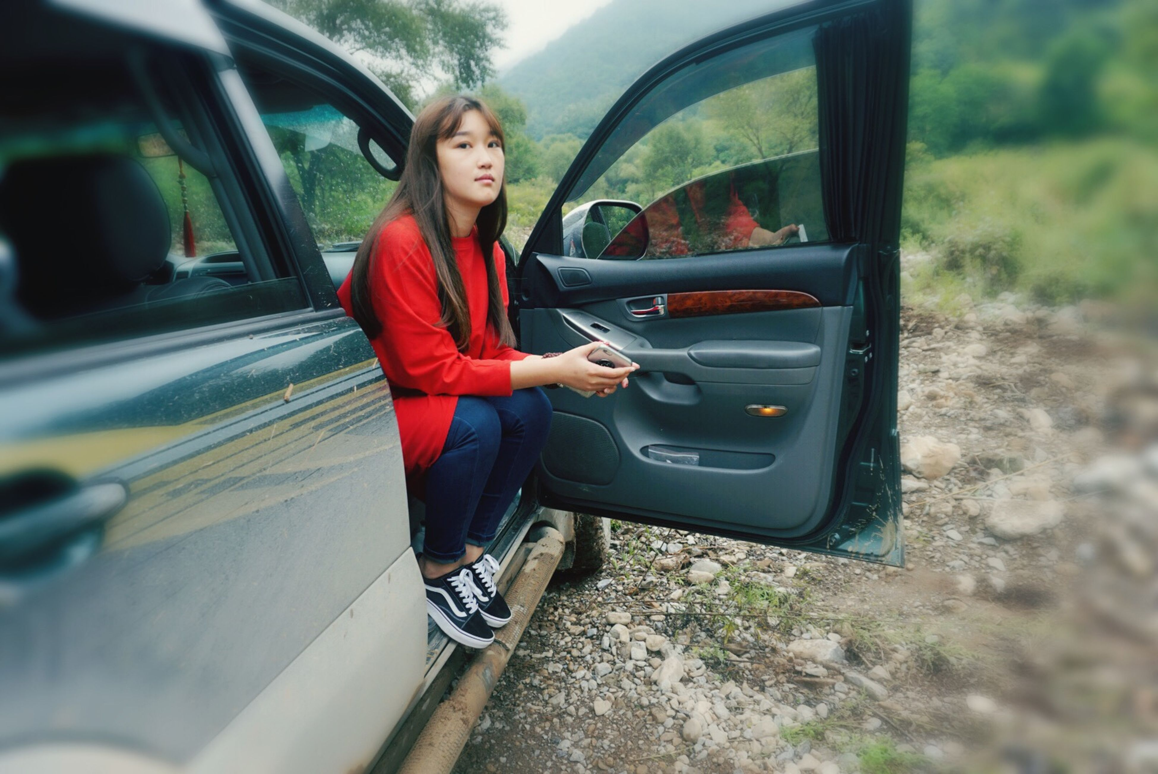 transportation, mode of transport, land vehicle, person, lifestyles, young adult, leisure activity, casual clothing, car, portrait, looking at camera, travel, sitting, front view, young women, smiling, full length, sunglasses