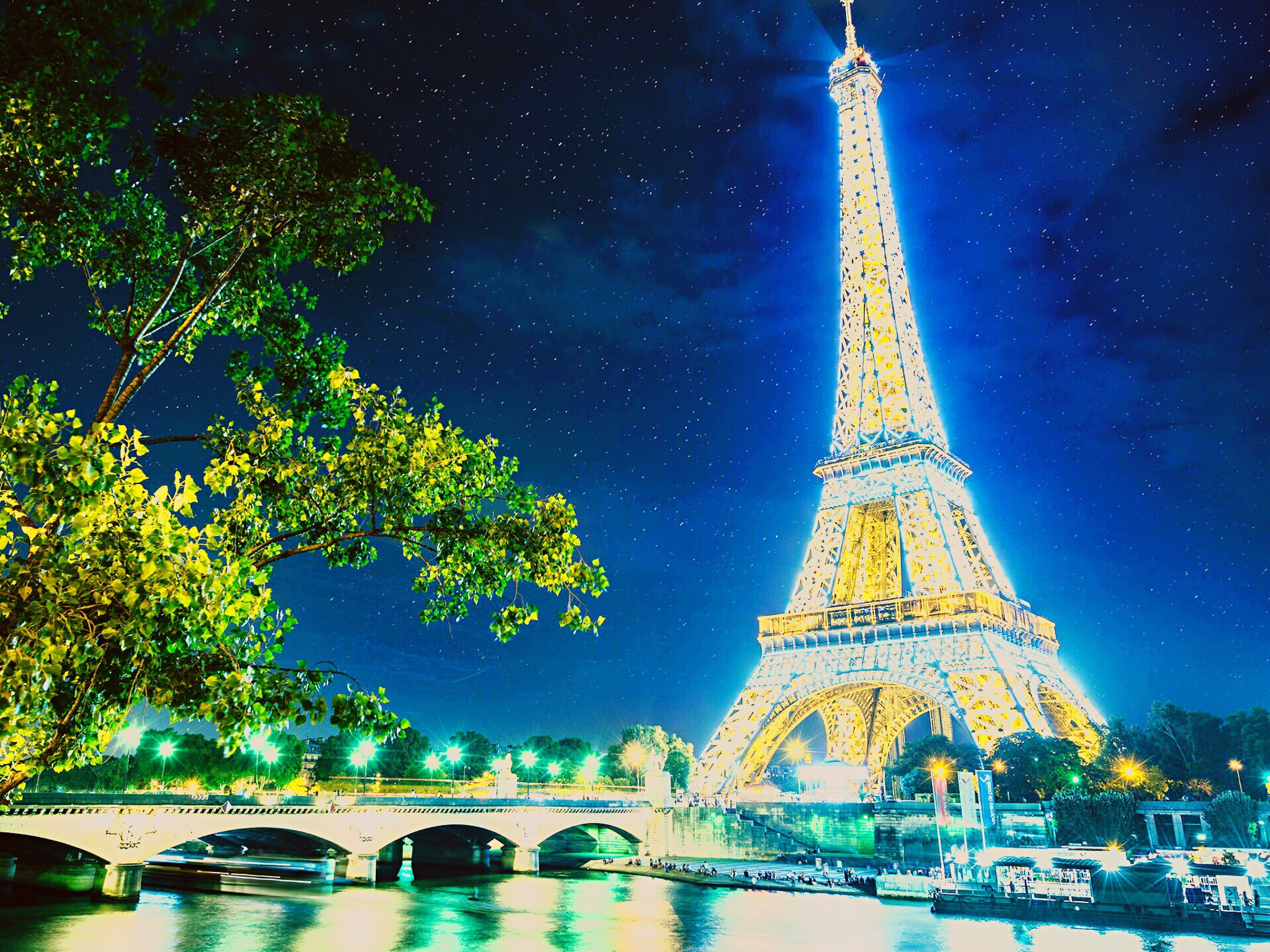 architecture, built structure, travel destinations, famous place, night, tourism, tree, international landmark, travel, sky, low angle view, illuminated, capital cities, religion, building exterior, blue, water, history, tower, connection