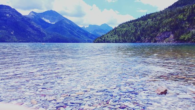 Lake Clear Water Rocks And Water Waterton National Park Sky Trees And Sky
