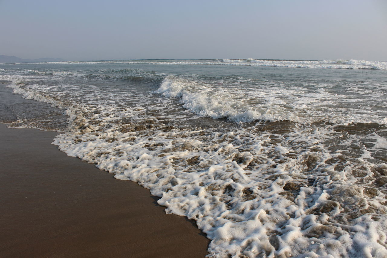 sea, nature, water, beauty in nature, shore, wave, beach, tranquility, scenics, no people, outdoors, sand, tranquil scene, day, clear sky, sky, horizon over water