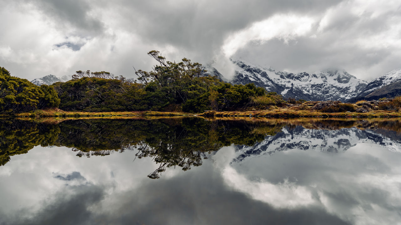 Amazing Breathtaking Cloud - Sky Clouds Day EyeEm Nature Lover EyeEmNewHere Fiordland Key Summit Track Lake Landscape National Park Nature No People Outdoors Reflection Reflection Lake Sky Snowcapped Mountain Stunning Symmetry Tranquility Tree View Water