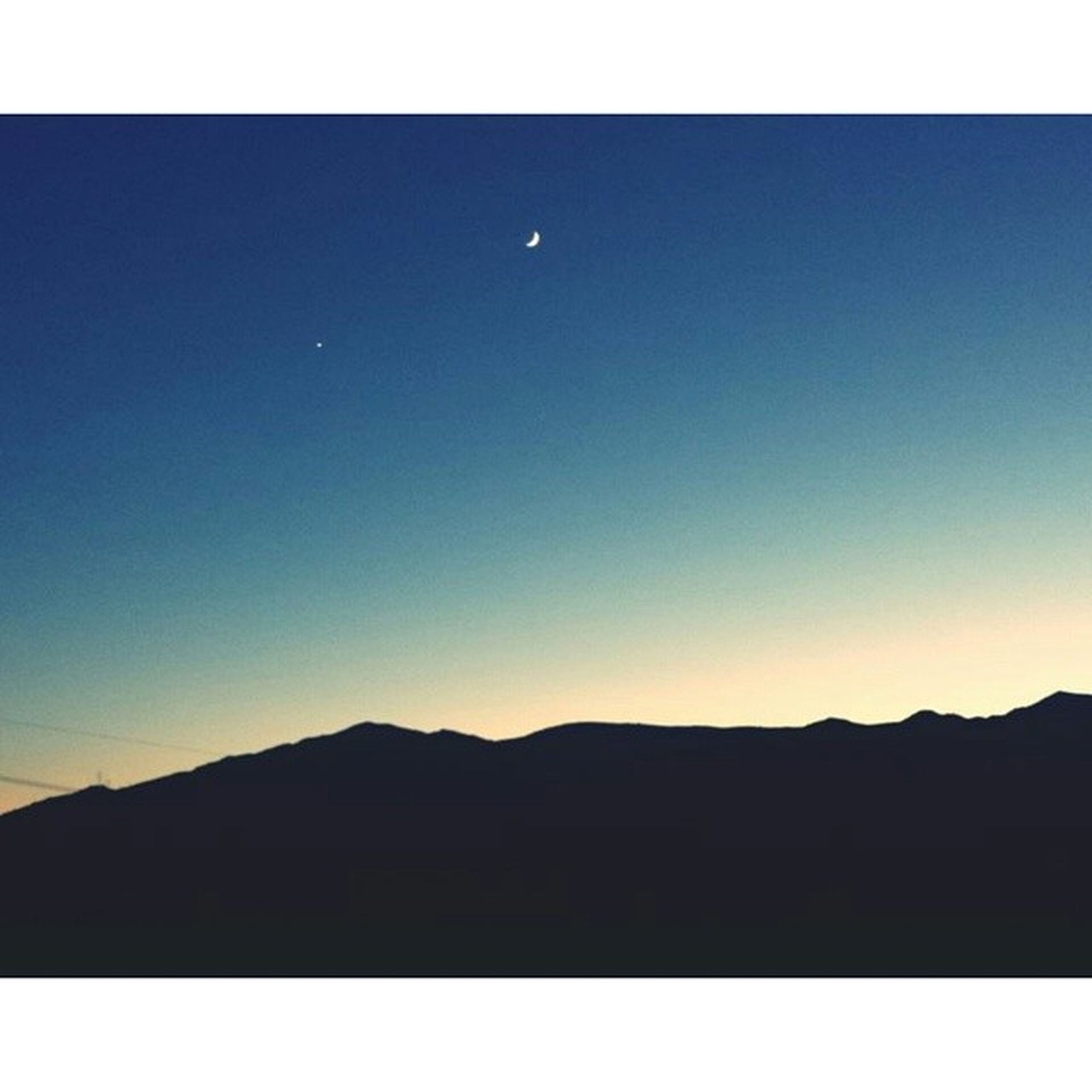 transfer print, clear sky, copy space, auto post production filter, mountain, tranquil scene, scenics, tranquility, beauty in nature, blue, silhouette, mountain range, nature, landscape, idyllic, outdoors, moon, no people, horizon over land, dusk
